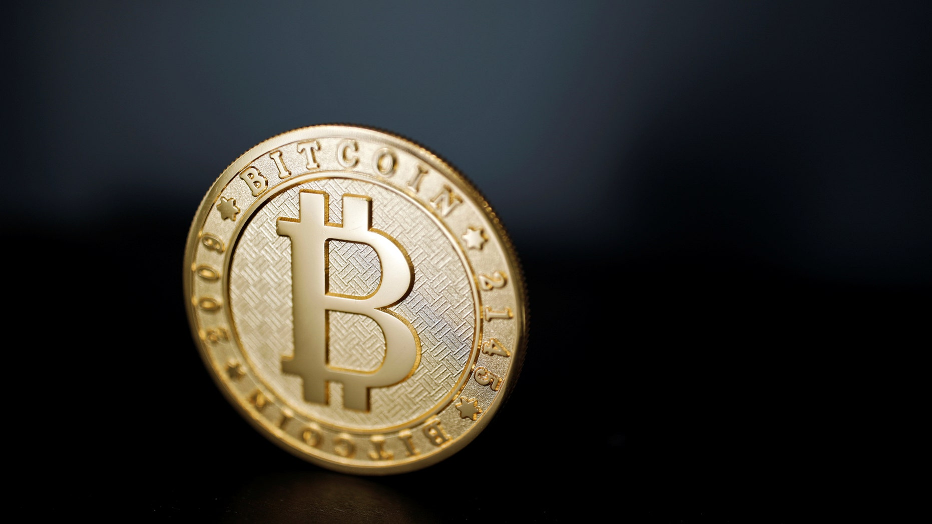 A Bitcoin is seen in a picture taken at La Maison du Bitcoin in Paris.