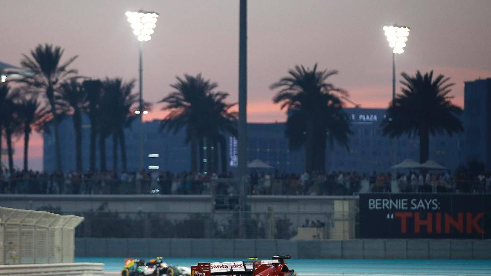 Ferrari driver Fernando Alonso of Spain races during the Emirates Formula One Grand Prix at the Yas Marina racetrack in Abu Dhabi, United Arab Emirates, Sunday, Nov. 23, 2014. (AP Photo/Luca Bruno)