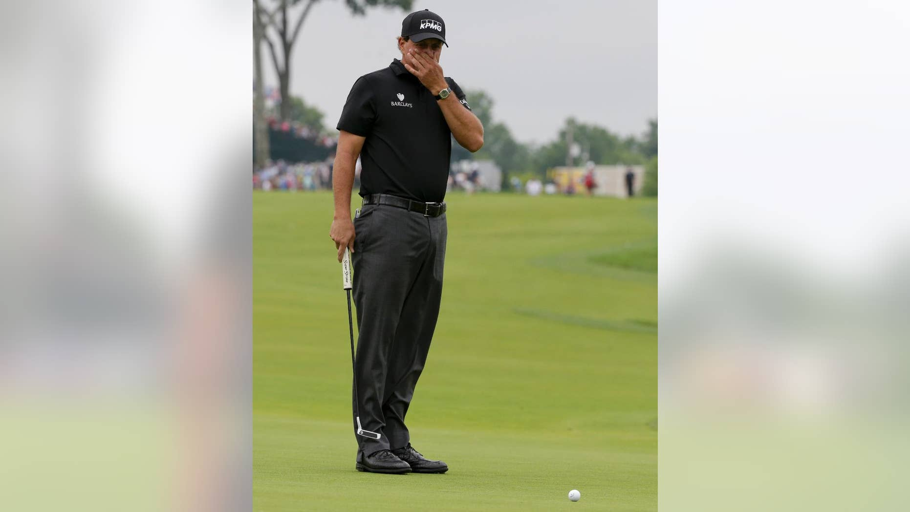 Phil Mickelson watches his putt on the 10th hole during the rain delayed first round of the U.S. Open golf championship at Oakmont Country Club on Friday, June 17, 2016, in Oakmont, Pa. (AP Photo/Gene J. Puskar)