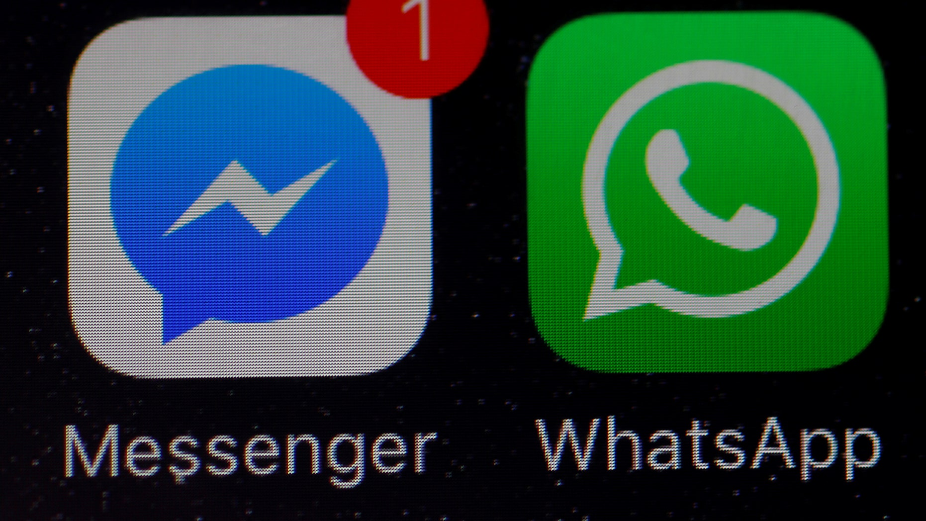 File photo: WhatsApp and Facebook messenger icons are seen on an iPhone in Manchester , Britain March 27, 2017. (REUTERS/Phil Noble)