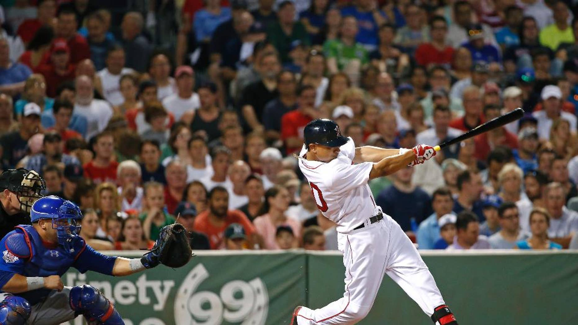 Boston Red Sox's Mookie Betts, right, hits a two-run home run in the fifth inning of a baseball game against the Chicago Cubs at Fenway Park in Boston, Wednesday, July 2, 2014. (AP Photo/Elise Amendola)