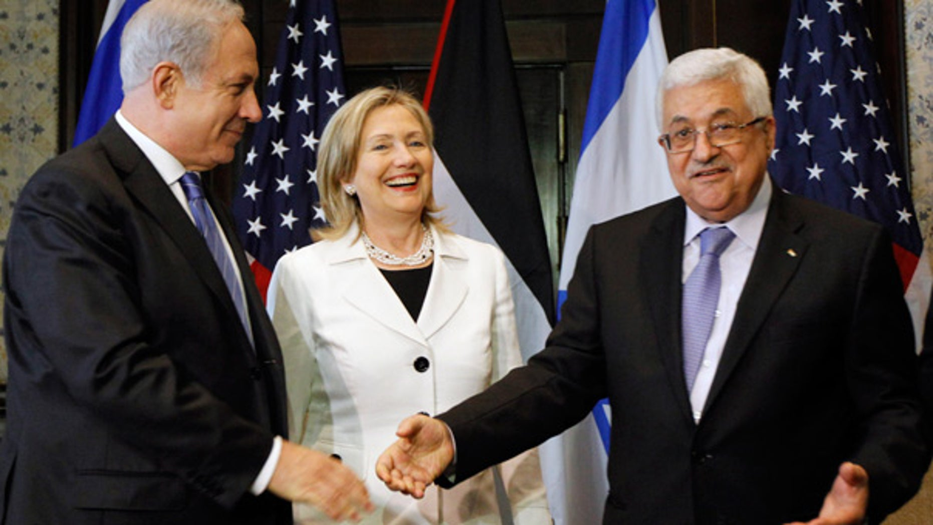 Sept. 14: Israeli Prime Minister Benjamin Netanyahu, left, shakes hands with Palestinian President Mahmoud Abbas, with Secretary of State Hillary Clinton in Egypt.