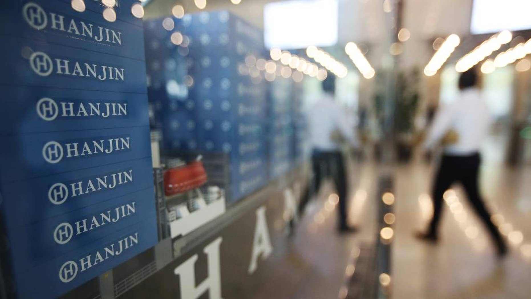 A model of container ship with Hanjin Shipping Co.'s logos is displayed at its head office in Seoul, South Korea, Thursday, Sept. 22, 2016. Hanjin Shipping is to receive as much as $100 million in additional funds to resolve the cargo crisis caused by its slide toward bankruptcy. (Park Dong-ju/Yonhap via AP) KOREA OUT
