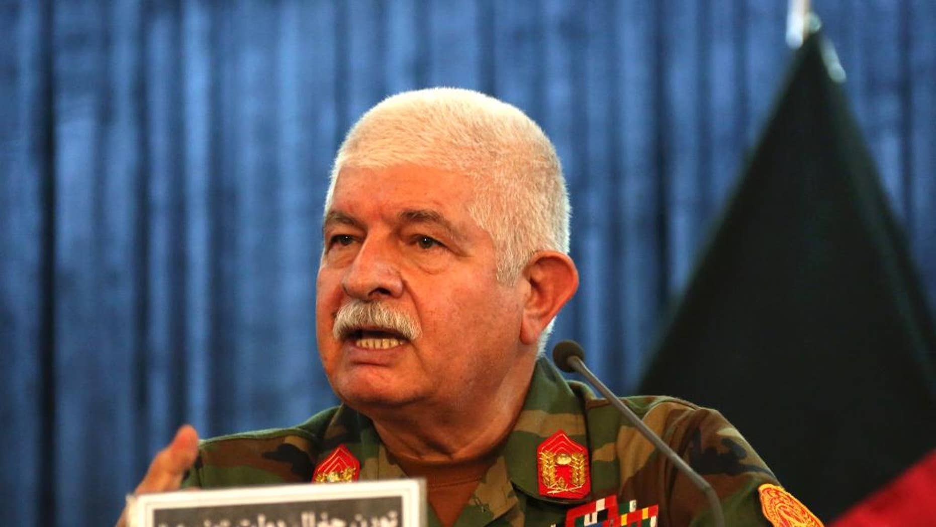 Gen. Dawlat Waziri, spokesman for the Afghan defense ministry, speaks during a press conference in Kabul, Afghanistan, Tuesday, Oct. 4, 2016. Fierce gun battles raged for a second day Tuesday across Afghanistan's embattled northern city of Kunduz after the Taliban launched a multipronged attack on the city they briefly captured last year, while in the south they took control of a district. (AP Photo)
