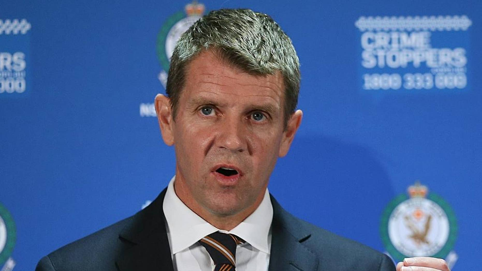 FILE - In this Dec. 16, 2015 file photo, New South Wales Premier Mike Baird speaks to the media during a press conference after a Lindt cafe siege at Martin Place in the central business district of Sydney, Australia. The leader of Australia's most populous state resigned Thursday, Jan. 19, 2017, after his popularity plummeted over a series of decisions during 2016. Baird used social media to announce that the ruling Liberal Party would elect a new leader at a meeting on Tuesday. (AP Photo/Rob Griffith, File)