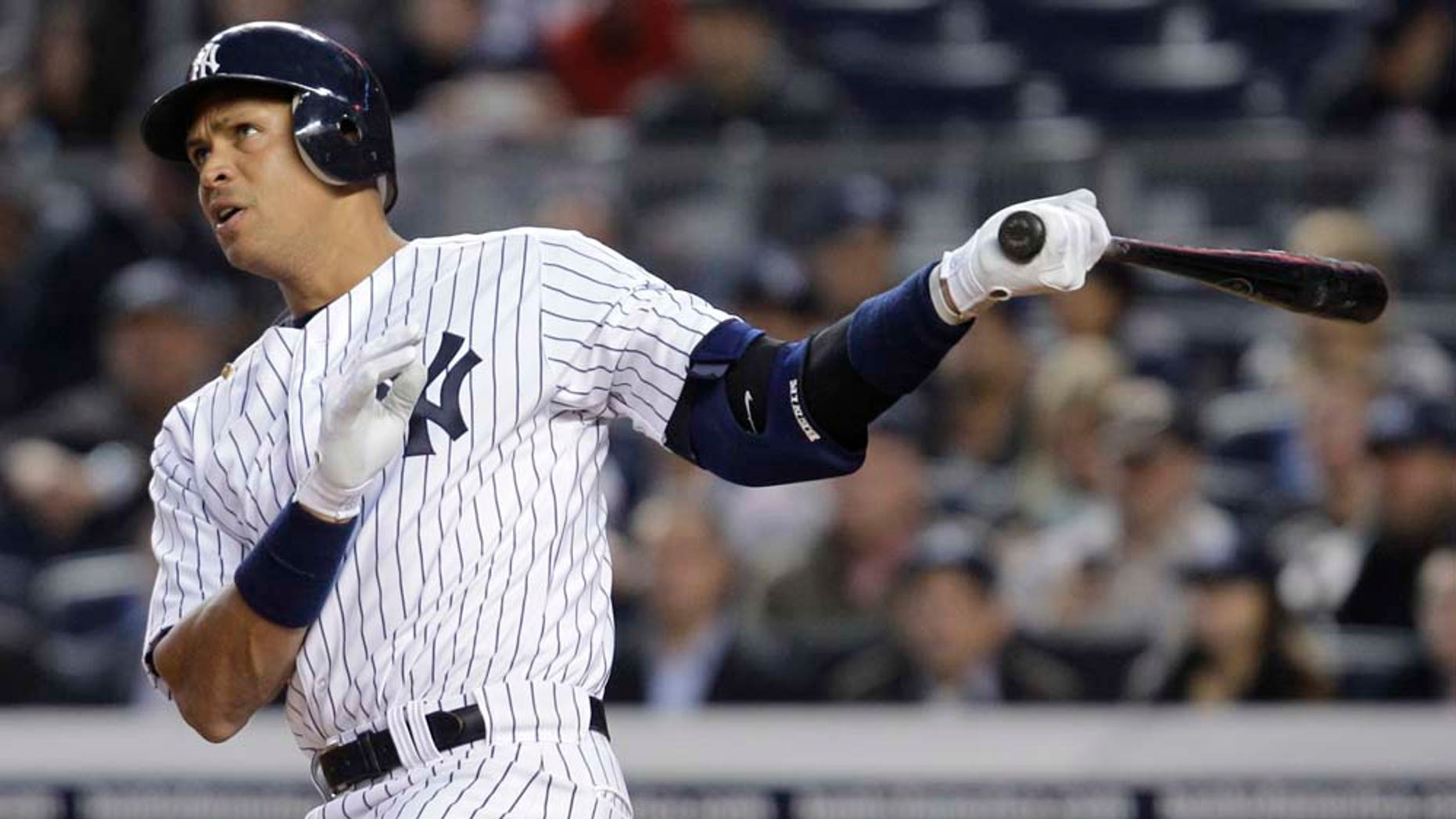 New York Yankees' Alex Rodriguez watches a home run sail off of his bat.