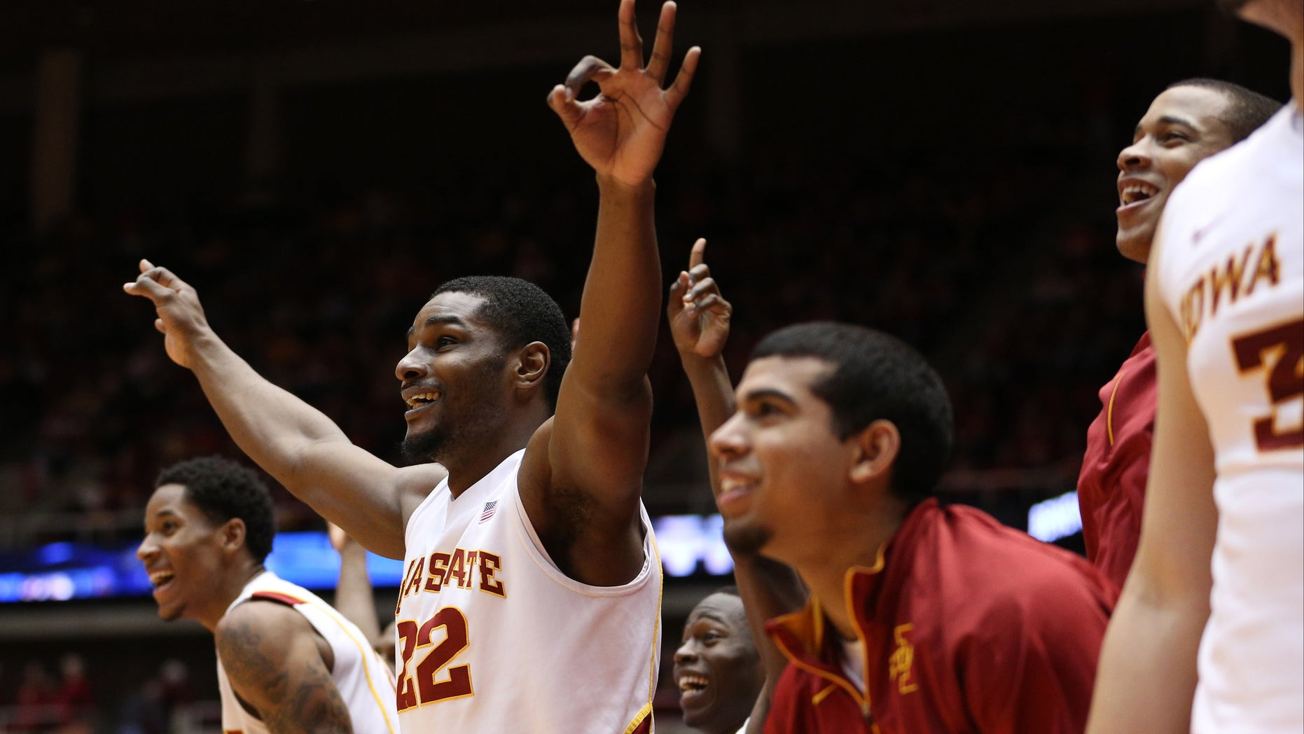 Iowa State forward Anthony Booker (22) and the rest of the Iowa State bench celebrate as Iowa State guard Nkereuwem Okoro (not shown) hits a three-pointer late in the second half of their NCAA college basketball game against TCU Saturday, Feb. 16, 2013, at Hilton Coliseum in Ames, Iowa. Iowa State won the game 87-53. (AP Photo/Justin Hayworth)
