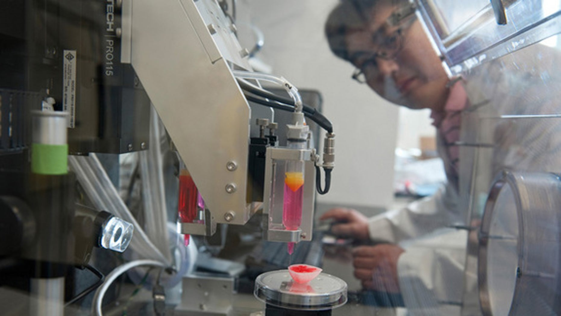 "Hyun-Wook Kang oversees the 3D printer that will be used to print miniature organs for the ""body on a chip"" system."