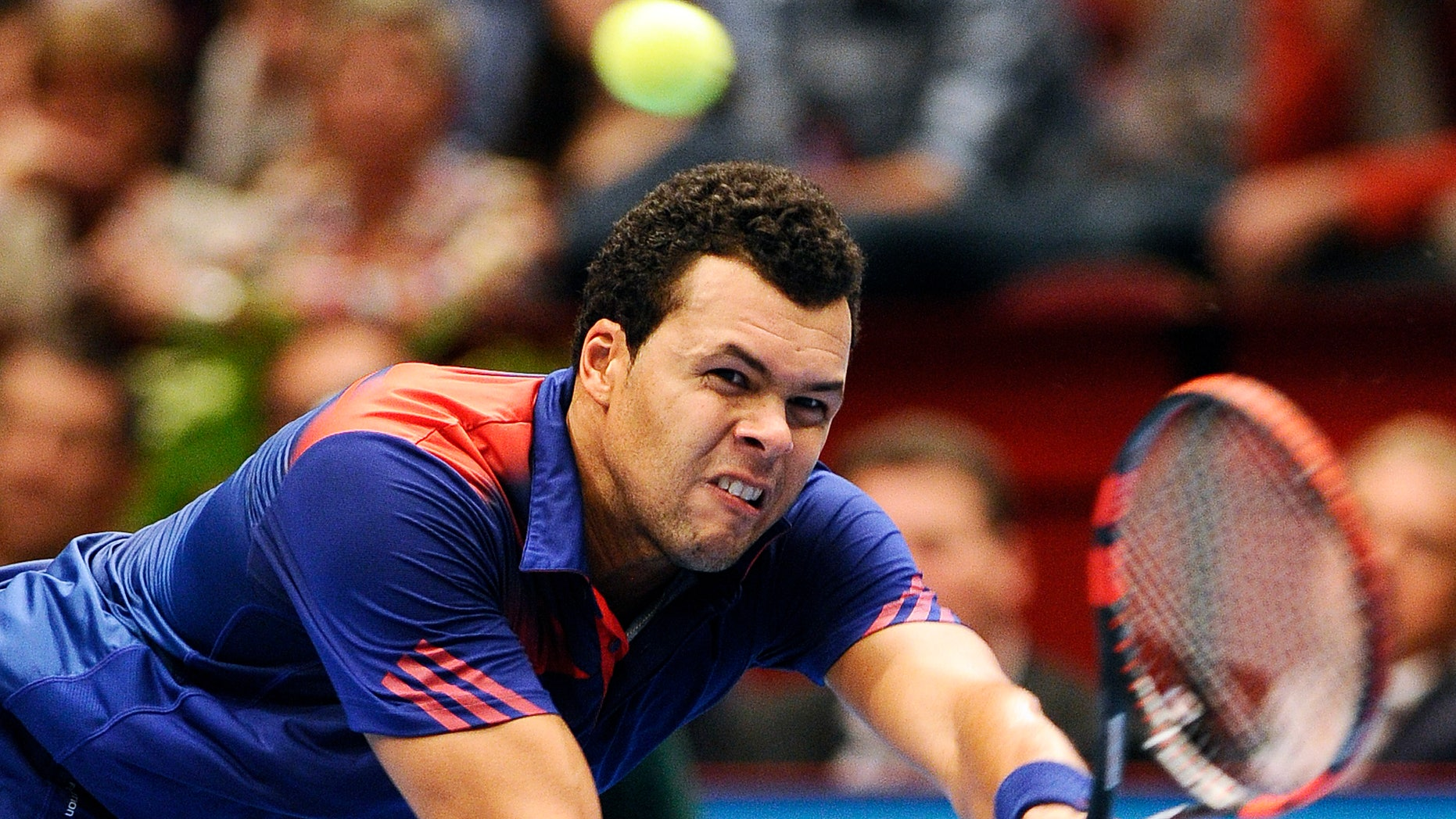 Jo-Wilfried Tsonga of France returns the ball to Robin Haase of the Netherlands during their semi final match at the Erste Bank Open tennis tournament in Vienna, Austria, Saturday, Oct. 19, 2013. (AP Photo/Hans Punz)