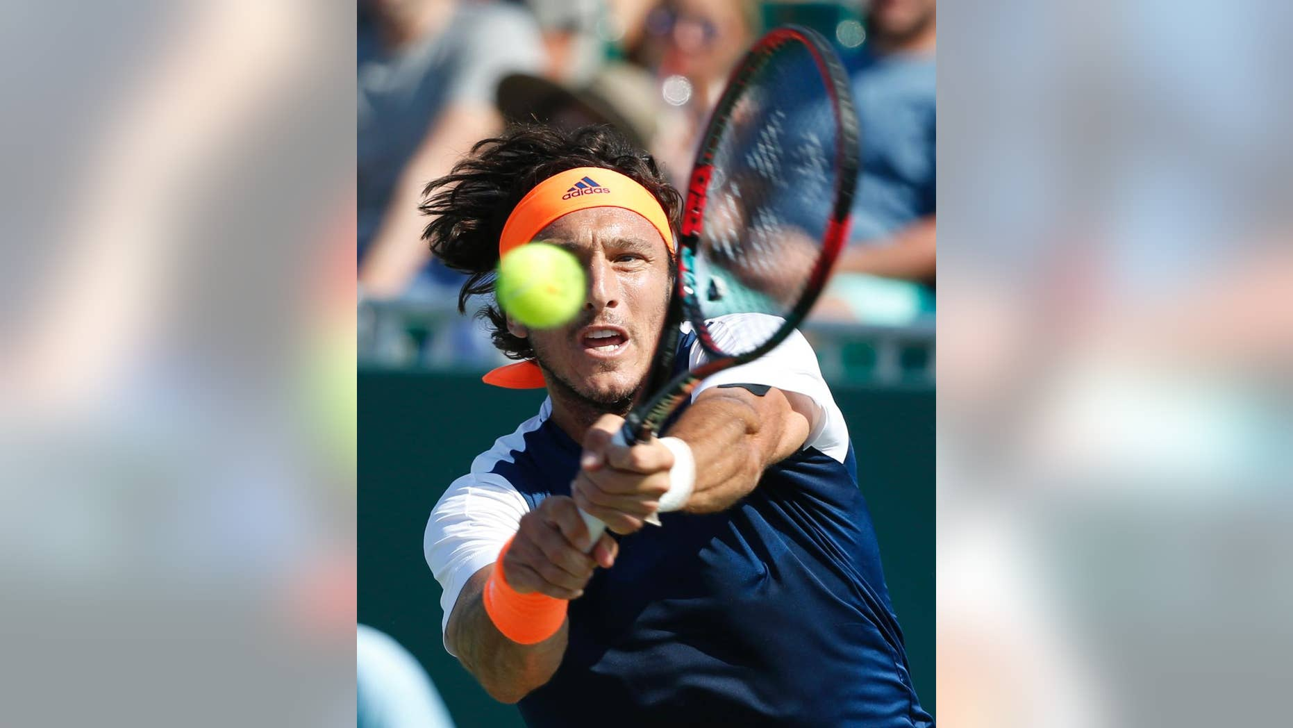 File.- In this March 22, 2017 file photo Juan Monaco returns a shot from Federico Delbonis, both of Argentina, during a tennis match at the Miami Open in Key Biscayne, Fla. Monaco, 33, announced Monday May 15 his retirement from competition.(AP Photo/Wilfredo Lee, File)