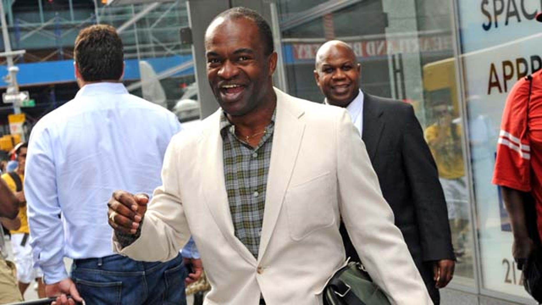 NFL player Association executive director DeMaurice Smith exits a law firm where contract  talks ended, Friday July 15, 2011, in New York. Significant progress on a major sticking point in the NFL labor impasse â soaring rookie salaries â during marathon talks Thursday raised hopes that a tentative agreement in principle could perhaps come within 24 hours, according to two people familiar with the negotiations. (AP Photo/ Louis Lanzano)