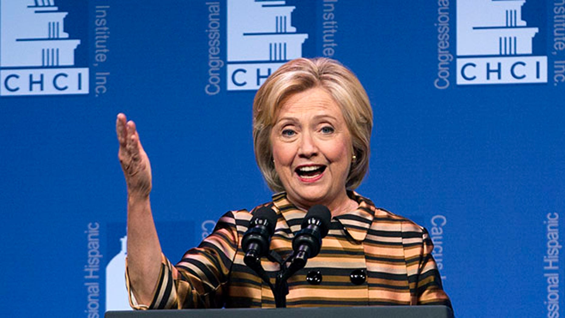 Democratic presidential candidate Hillary Clinton speaks to the Congressional Hispanic Caucus Institute's 39th Annual Gala Dinner held at the Washington Convention Center, in Washington, Thursday, Sept. 15, 2016. Clinton returned to the campaign trail after a bout of pneumonia that sidelined her for three days and revived questions about both Donald Trump's and her openness regarding their health..( AP Photo/Jose Luis Magana)