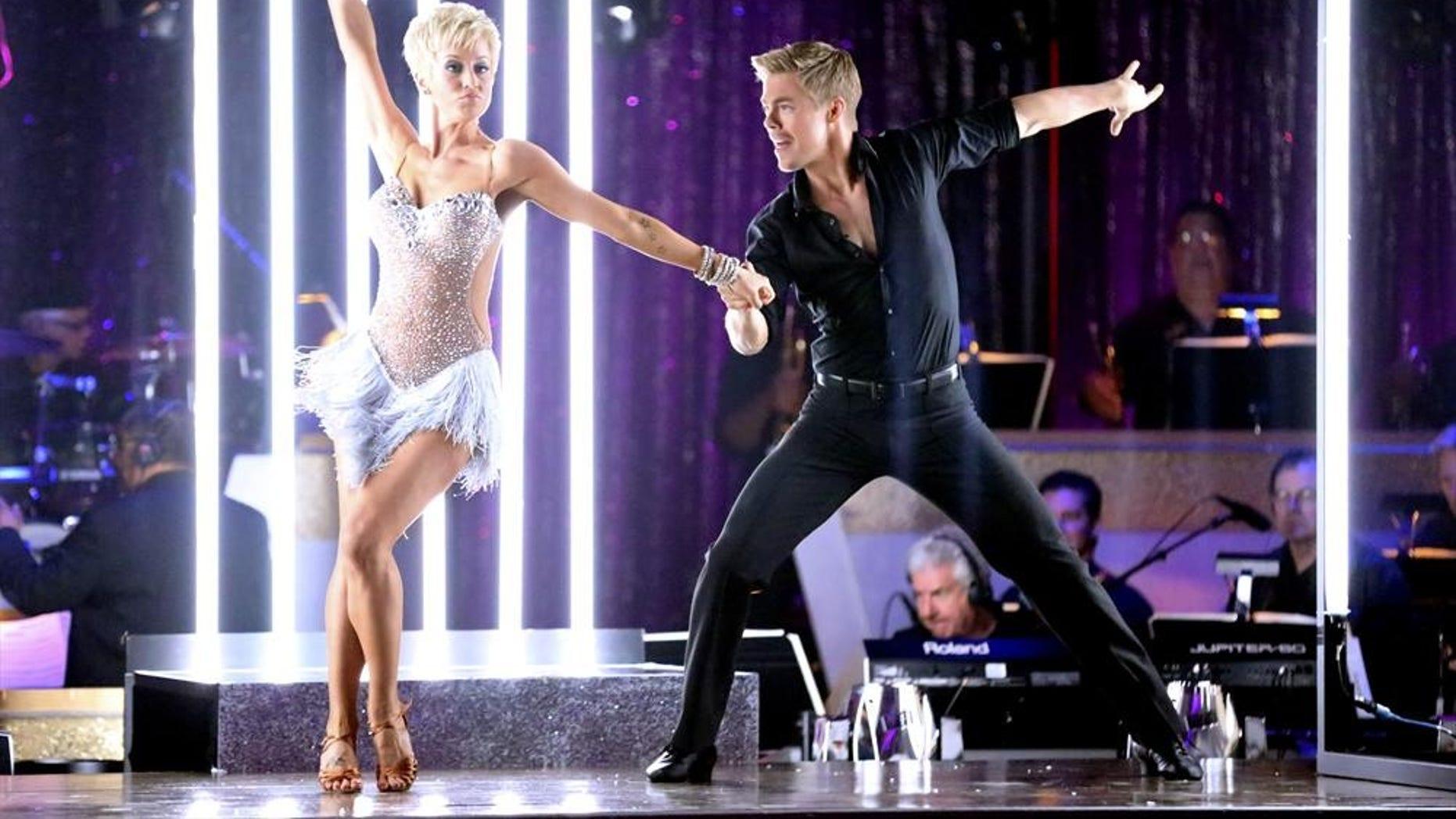 Singer Kellie Pickler and professional dancer Derek Hough competing on Dancing with the Stars.