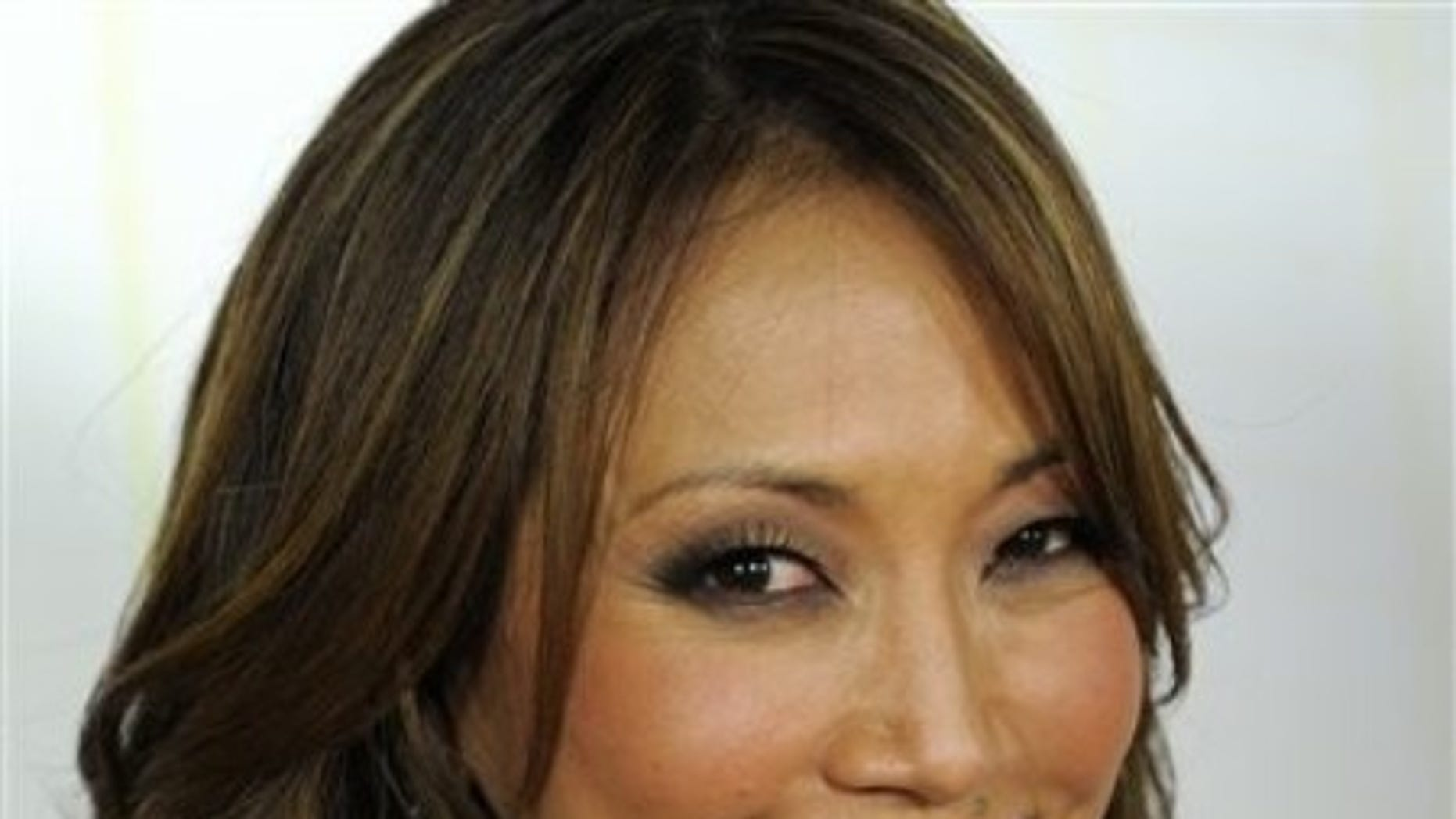 """FILE - In this Sept. 20, 2010 file photo, Carrie Ann Inaba poses at the 11th season premiere of """"Dancing with the Stars."""" (AP Photo/Chris Pizzello, file)"""