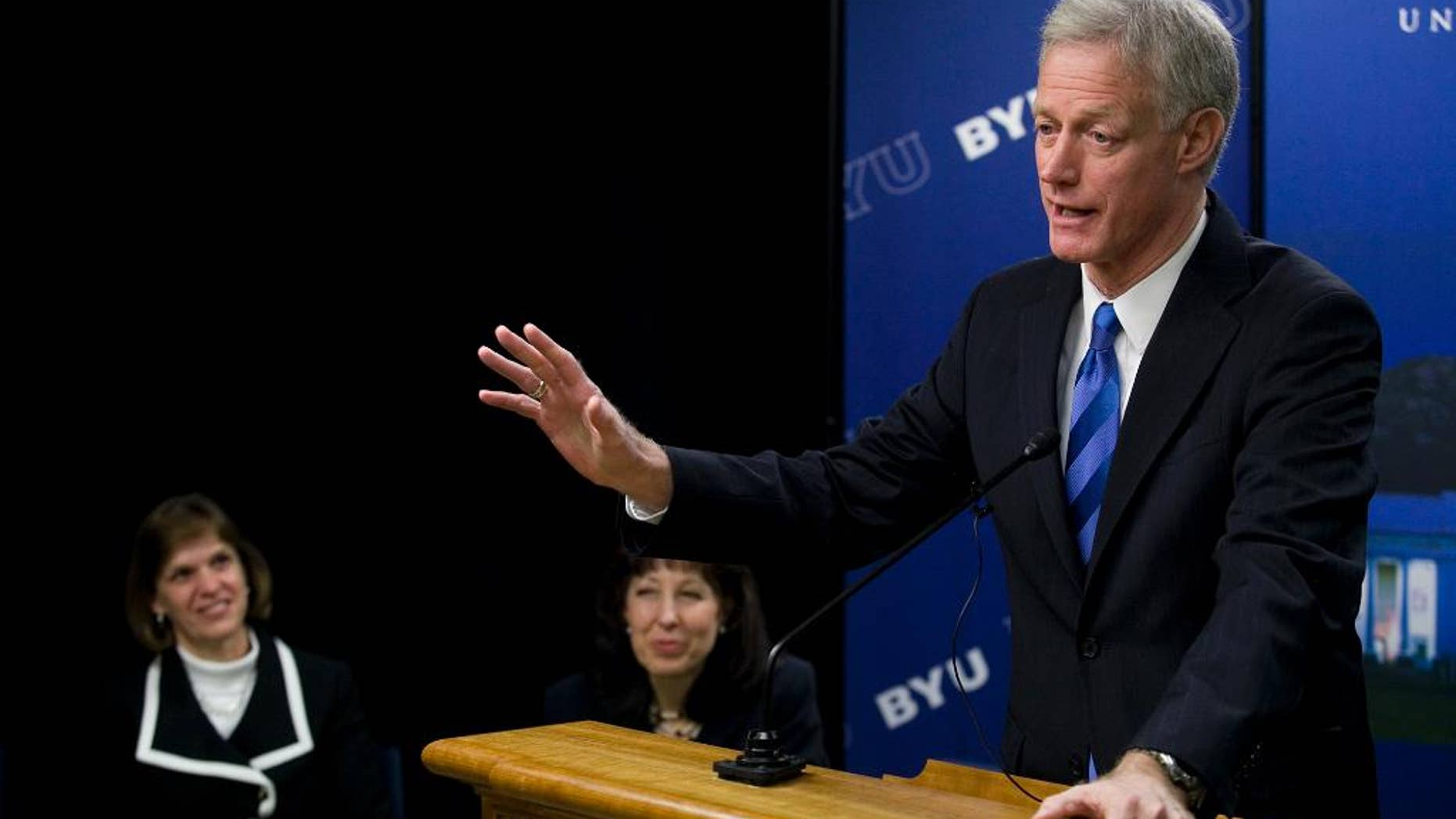 FILE - This March 11, 2014, file photo, Kevin Worthen, the newly-appointed president of Brigham Young University, speaks during a news conference, in Provo, Utah. Worthen says a faculty advisory council created to review how the school handles reports of sexual assault will present its findings this fall. The Daily Herald of Provo reports that Worthen made the comments Monday during a talk to BYU faculty. (Mark Johnston/The Daily Herald via AP)
