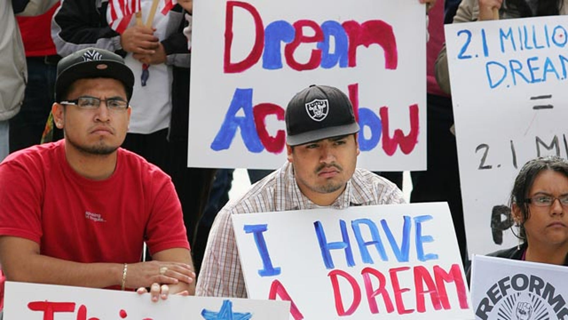 Miguel Campos, left and Eduardo Rodriguez hold signs in support of Fresno State Student Body President Pedro Ramirez who spoke to hundreds of students and faculty about getting the Dream Act passed by Congress Friday, Nov. 19, 2010 in Fresno, Calif. in the Free Speech area of the university. Ramirez was recently outted as being undocumented and could now face deportation. The legislation would grant undocumented students who were brought into the United States as minors by their parents a path to citizenship through higher education or military service. (AP Photo/Gary Kazanjian)