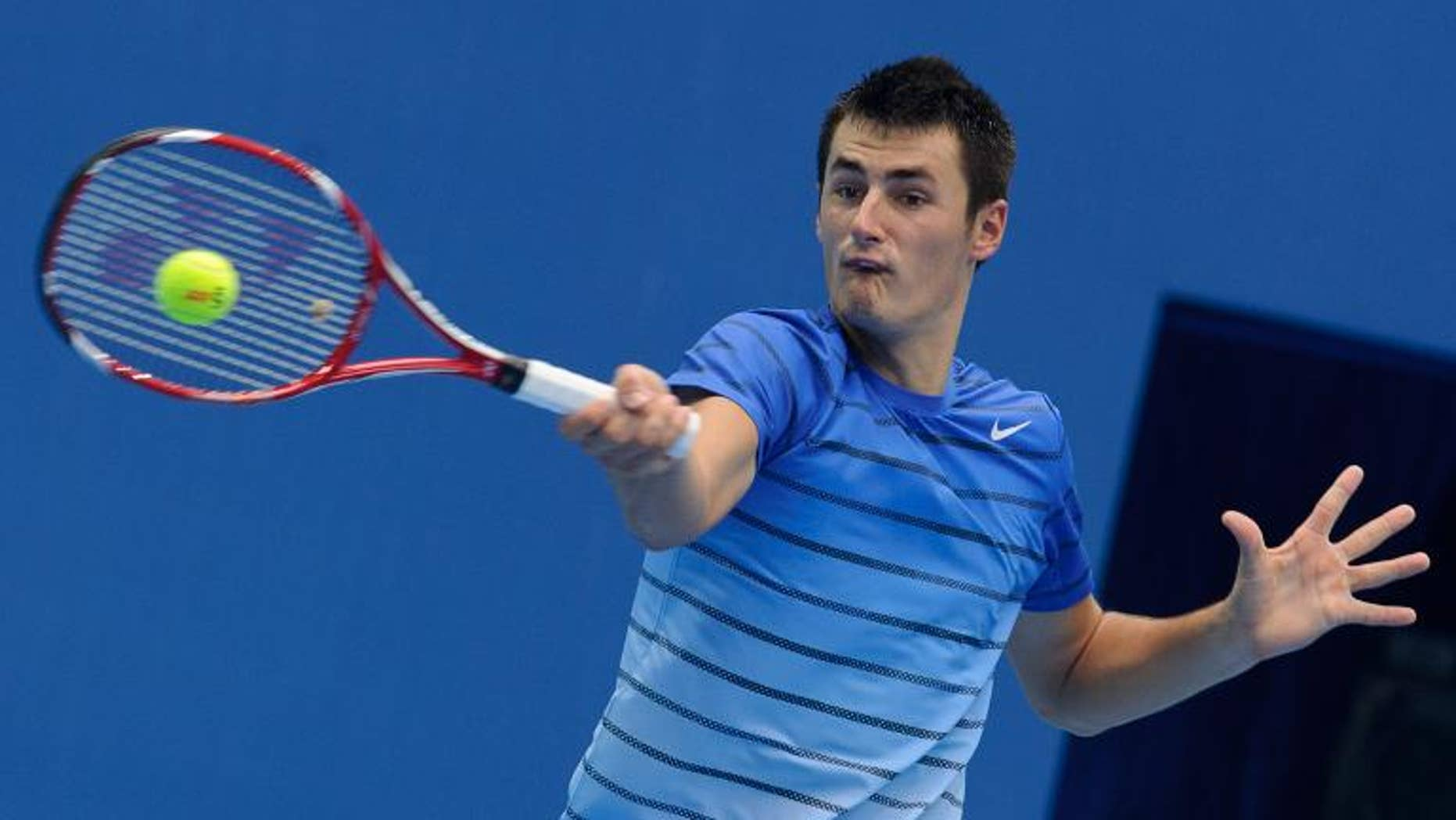 Australia's Bernard Tomic hits a return to China's Zhang Ze during their first round match at the China Open in Beijing on September 30, 2013. Tomic won 7-5, 6-4.