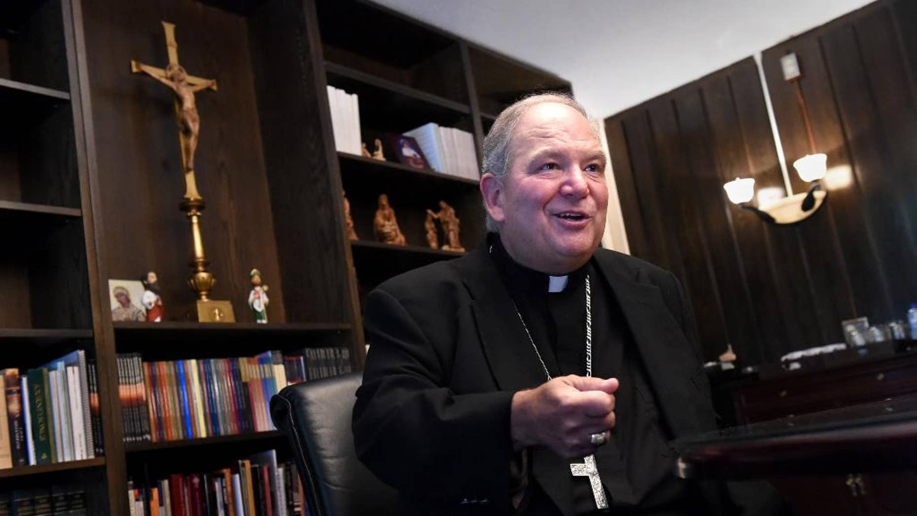 Archbishop Bernard Hebda, interim leader of the Archdiocese of St. Paul and Minneapolis, speaks during an interview in St. Paul, Minn. on Friday, July 10, 2015. Under his predecessor, Archbishop John Nienstedt, the archdiocese was shaken by a clergy sex abuse scandal, criminal charges and bankruptcy. Hebda says he'll collaborate with a wide variety of people on how to formulate a plan to rebuild the archdiocese. He celebrates his first Mass in the archdiocese Sunday at the St. Paul Cathedral. (Jean Pieri/The St. Paul Pioneer Press via AP)