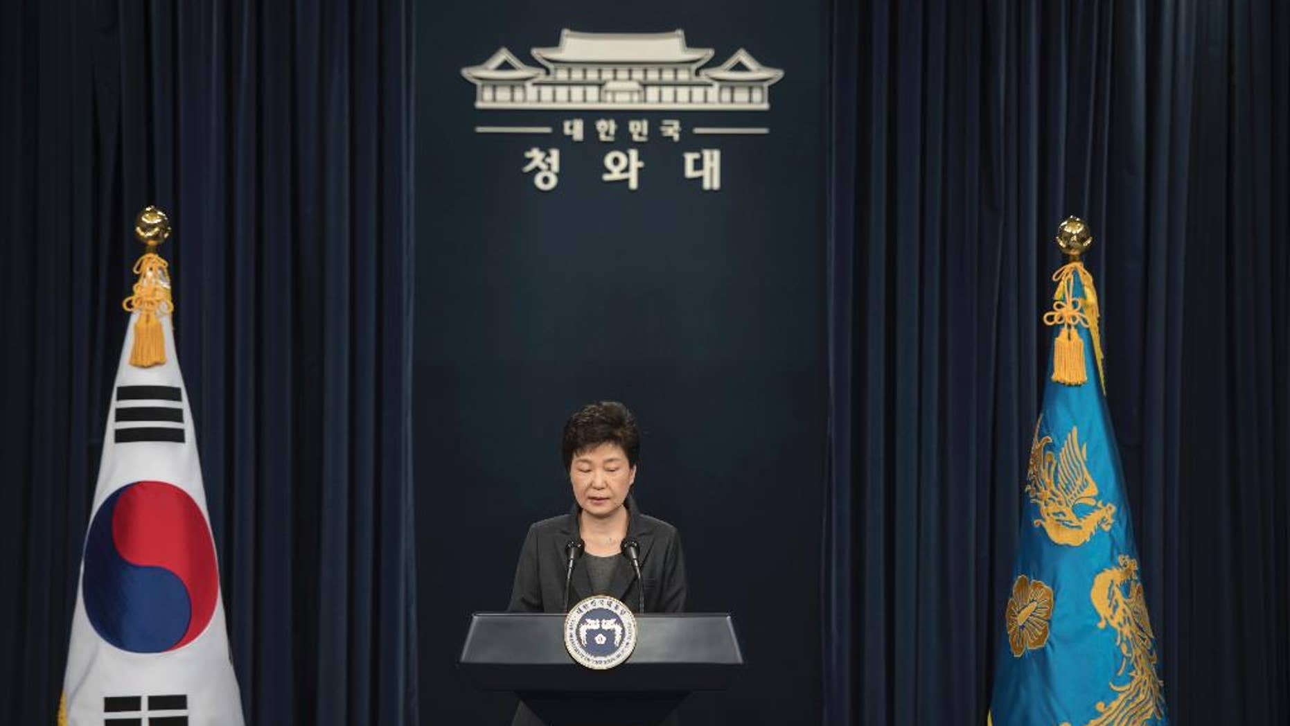 """South Korean President Park Geun-hye addresses the nation at the presidential Blue House in Seoul Friday, Nov. 4, 2016. Park took sole blame Friday for a """"heartbreaking"""" scandal that threatens her government and vowed she will accept a direct investigation into her actions amid rising suspicion that she allowed a mysterious confidante to manipulate power from the shadows. (Ed Jones/Pool Photo via AP)"""