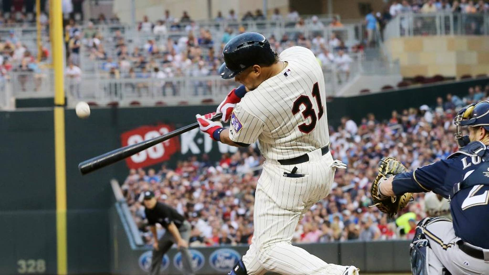 Minnesota Twins' Oswaldo Arcia hits a three-run home run off Milwaukee Brewers  pitcher Marco Estrada in the fourth inning of a baseball game, Wednesday, June 4, 2014, in Minneapolis. (AP Photo/Jim Mone)