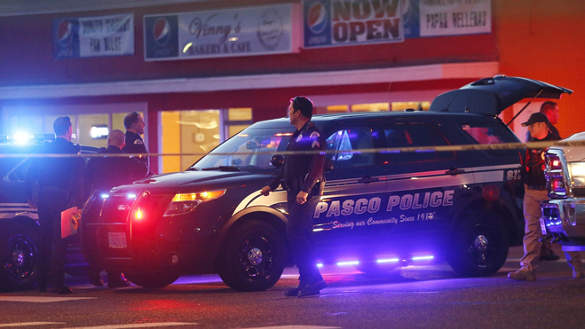 Police investigate the scene of an officer involved shooting Tuesday, Feb. 10. 2015 in Pasco, Wash.