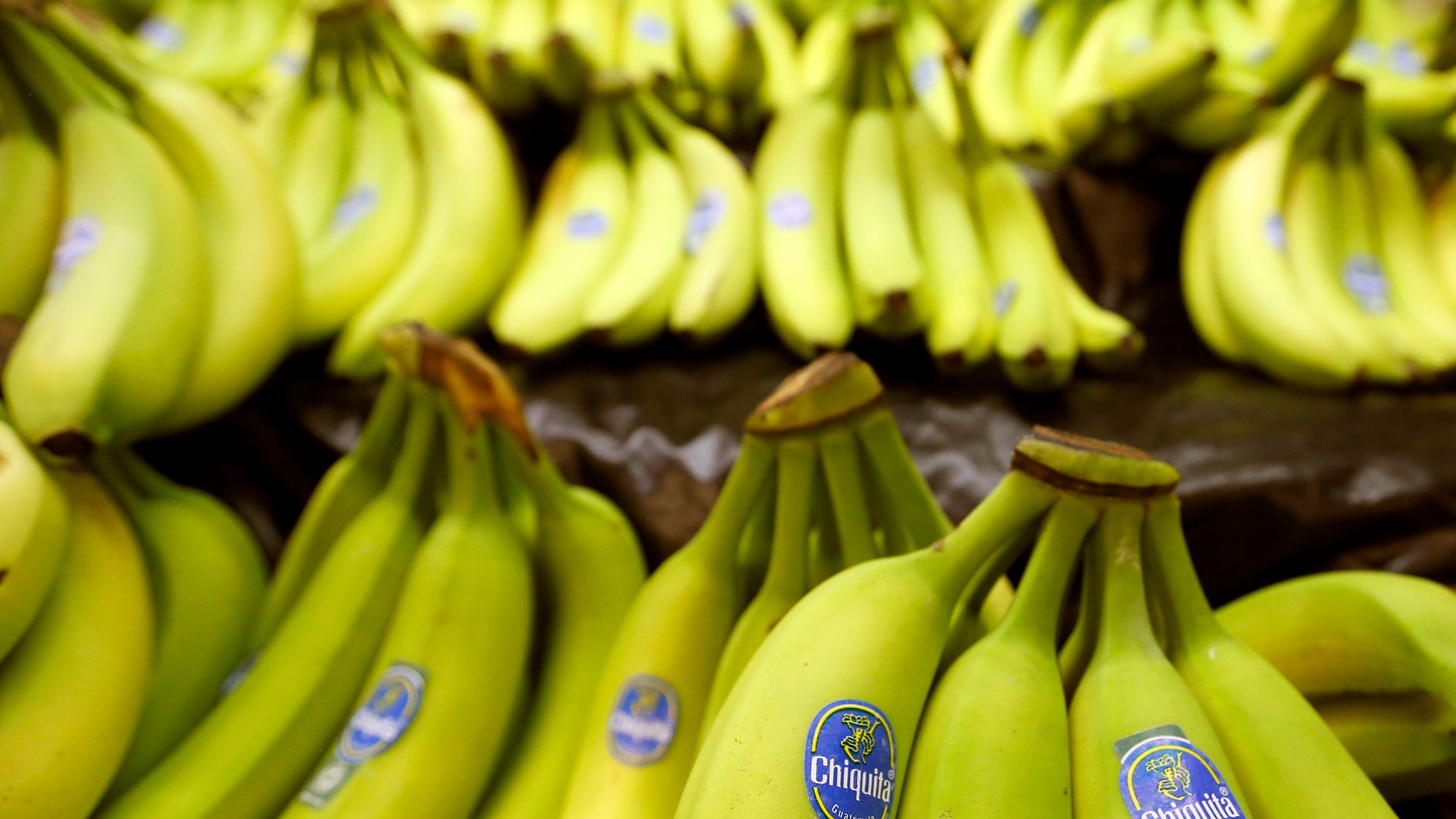 FILE - This Sept. 10, 2014 file photo shows bunches of Chiquita brand bananas for sale at a grocery store in Zelienople, Pa. Chiquita Brands International Inc. on Monday, Oct. 27, 2014 said it has agreed to sell itself to two Brazilian companies for approximately $681 million, just days after the fresh produce company's shareholders rejected plans to merge with Irish fruit importer Fyffes. (AP Photo/Keith Srakocic, File)
