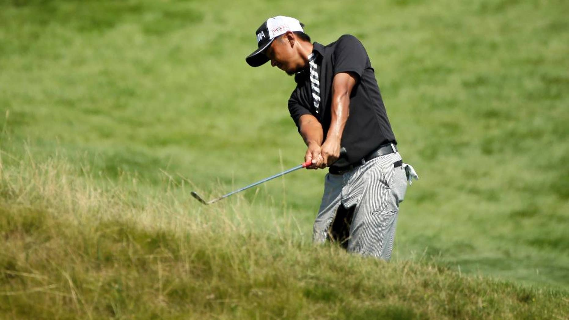 Hiroshi Iwata, of Japan, hits on the 18th hole during the second round of the PGA Championship golf tournament Friday, Aug. 14, 2015, at Whistling Straits in Haven, Wis. (AP Photo/Chris Carlson)