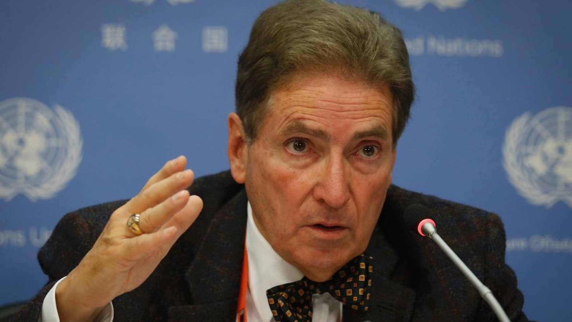 Alfred de Zayas, U.N. independent expert on international order, hold a news conference calling for the abolition of tax havens, Friday, Oct. 21, 2016, at U.N. headquarters. (AP Photo/Bebeto Matthews)