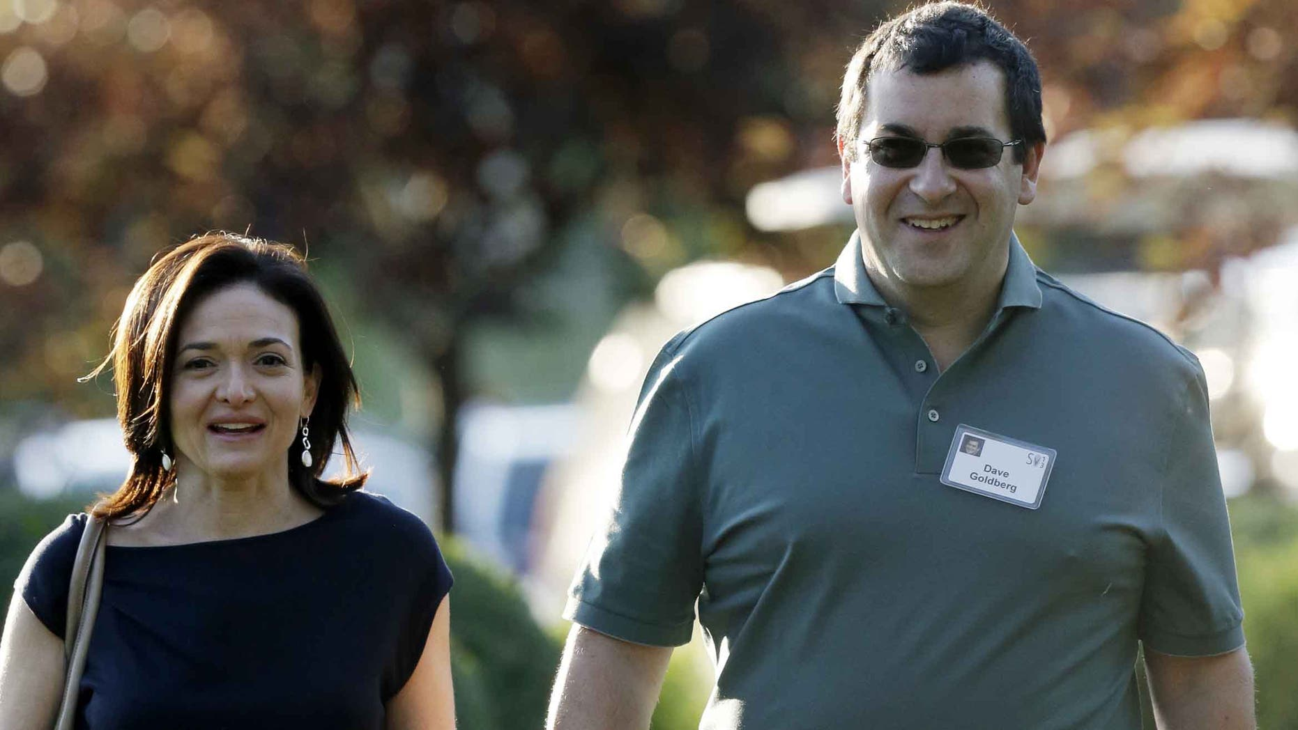 Sheryl Sandberg, COO of Facebook, and her husband David Goldberg in a 2013 file photo.