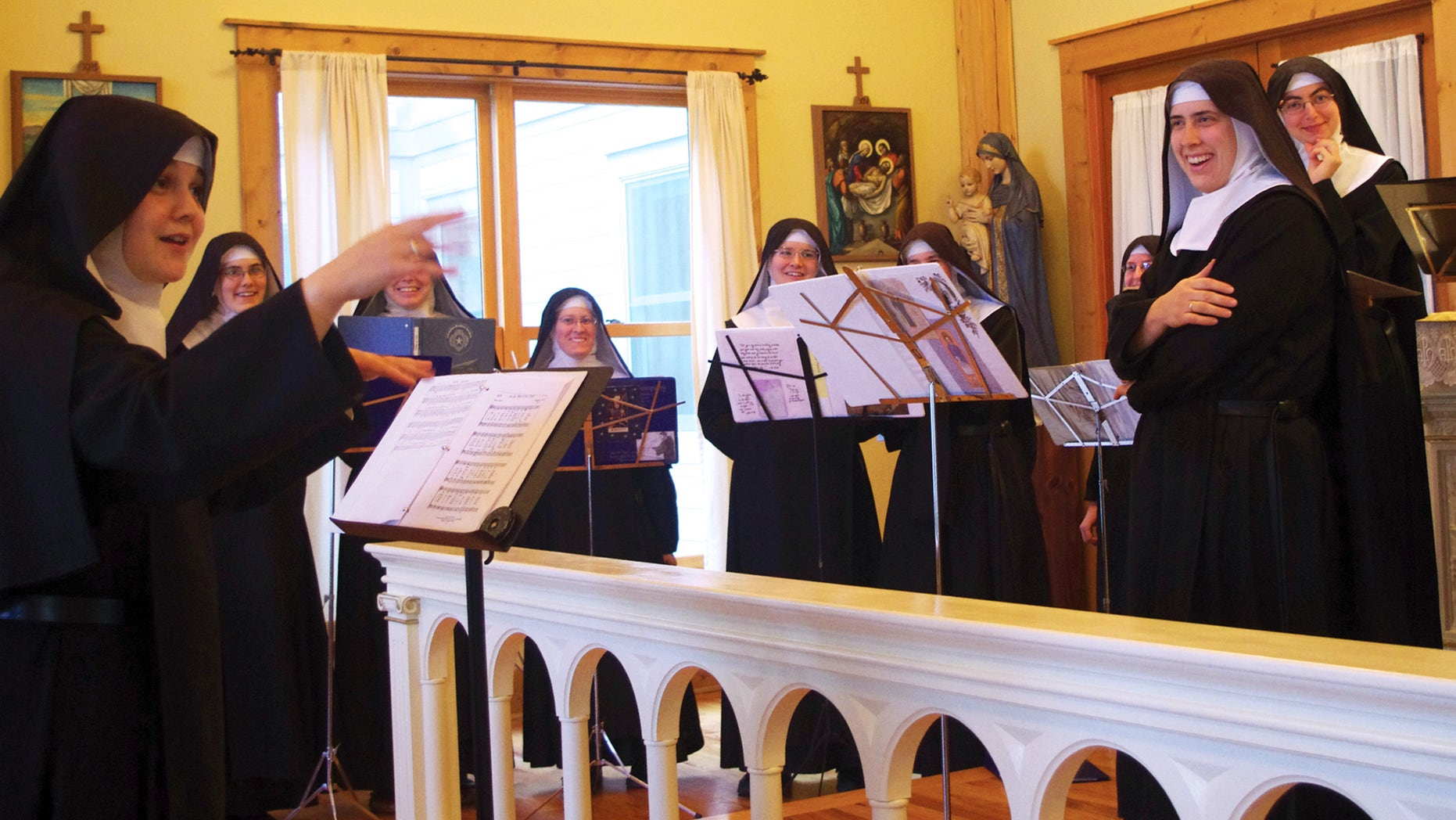 "Nov. 18, 2013. Mother Cecilia, left, conducts the Sisters during the recording sessions for ""Lent at Ephesus"" in the chapel at the Priory of The Benedictines of Mary called ""Ephesus"" near Gower, Mo. The Benedictines of Mary were named Billboard's Top Traditional Classical Album Artist of 2013, for the second year in a row."