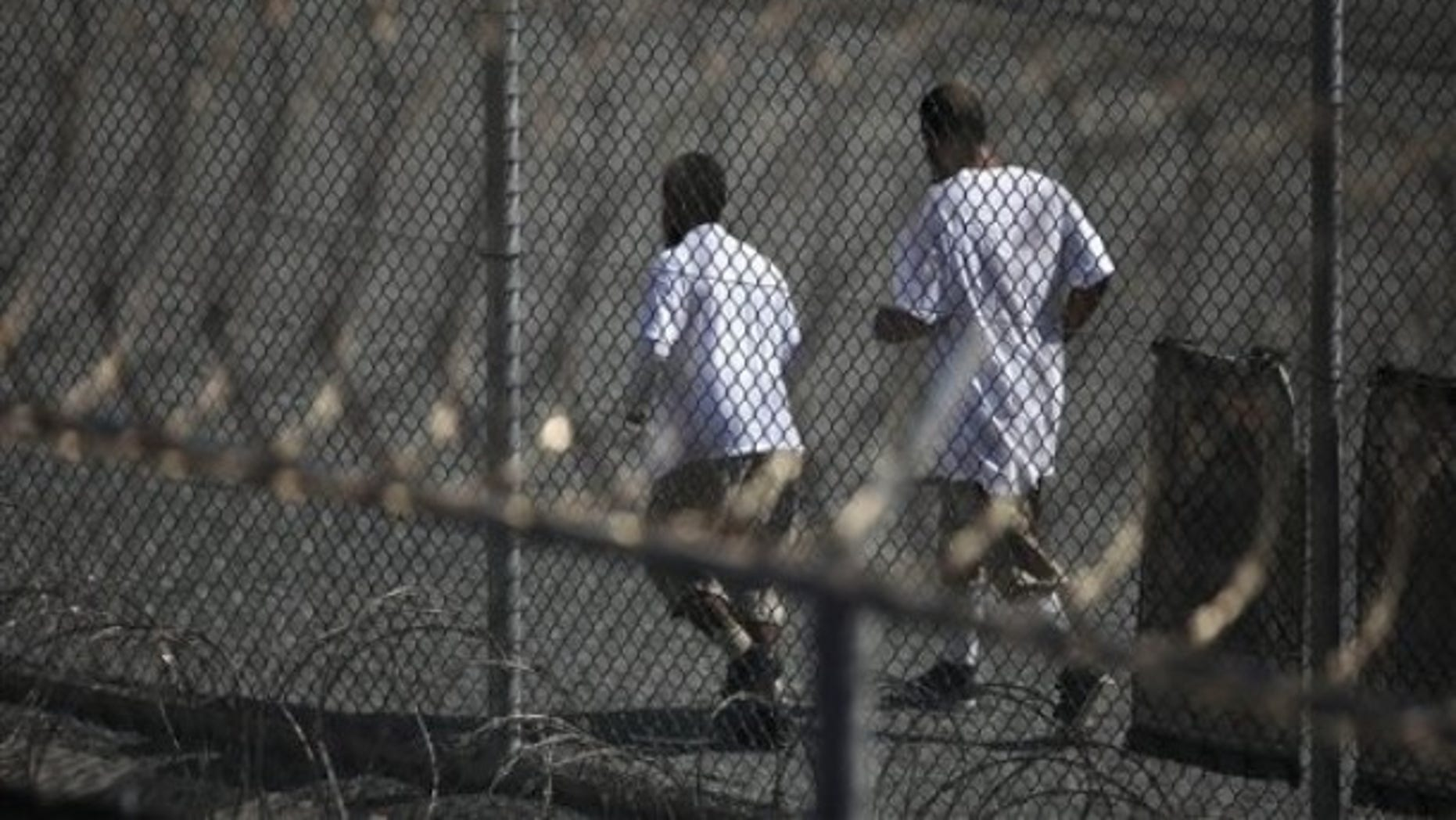 In this photo, reviewed by the U.S. military, Guantanamo detainees jog together inside a recreation area at Camp 6 high-security detention facility at Guantanamo Bay U.S. Naval Base, Cuba, Tuesday, March 30, 2010. (AP)