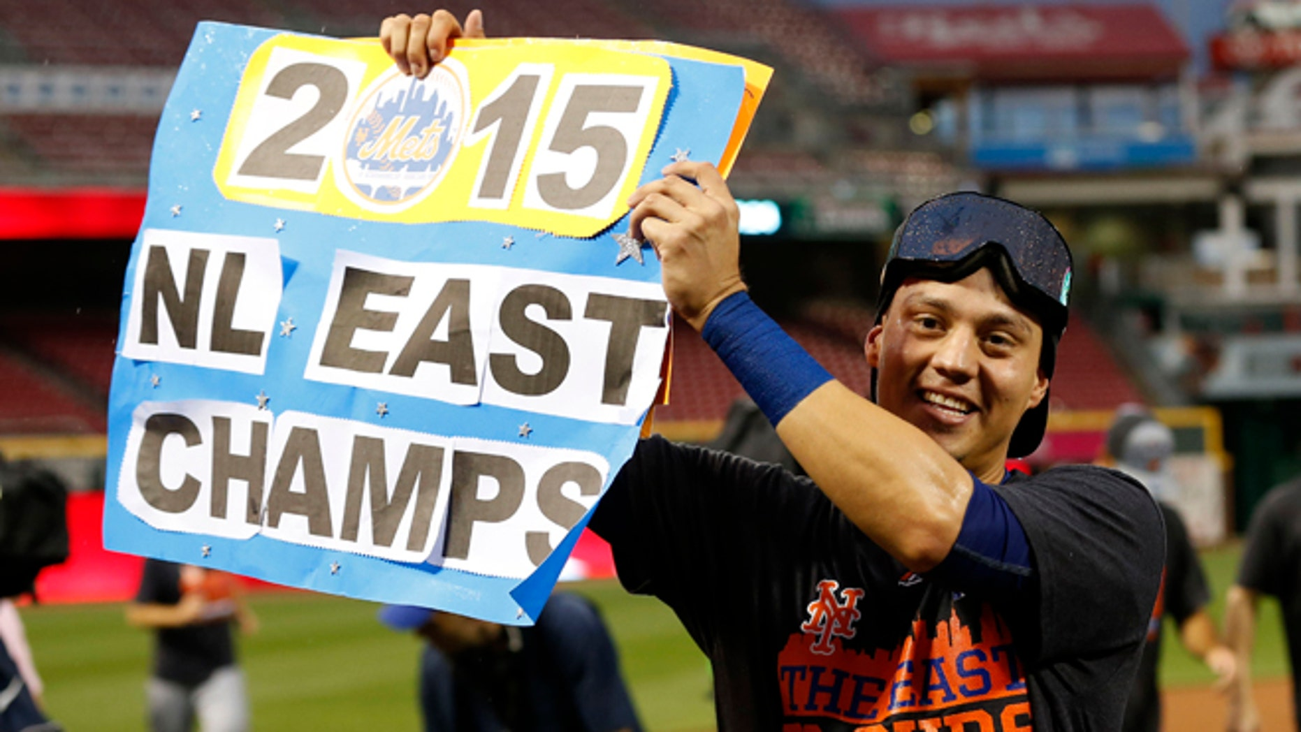 Wilmer Flores after clinching the NL East title Saturday, Sept. 26, 2015, in Cincinnati.