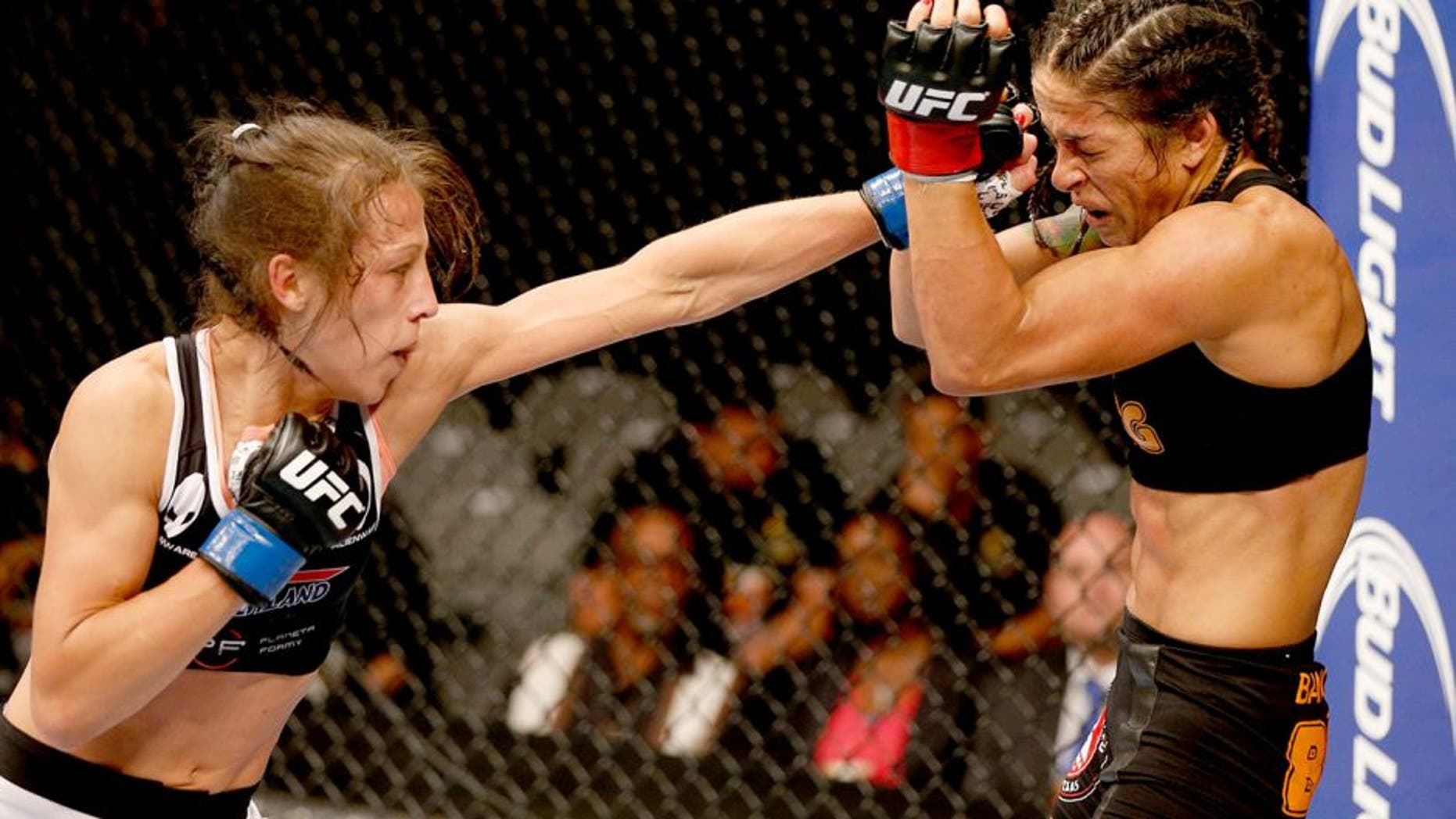 SAN JOSE, CA - JULY 26: (L-R) Joanna Jedrzejczyk punches Julianna Lima in their womens strawweight bout during the UFC Fight Night event at SAP Center on July 26, 2014 in San Jose, California. (Photo by Josh Hedges/Zuffa LLC/Zuffa LLC via Getty Images)