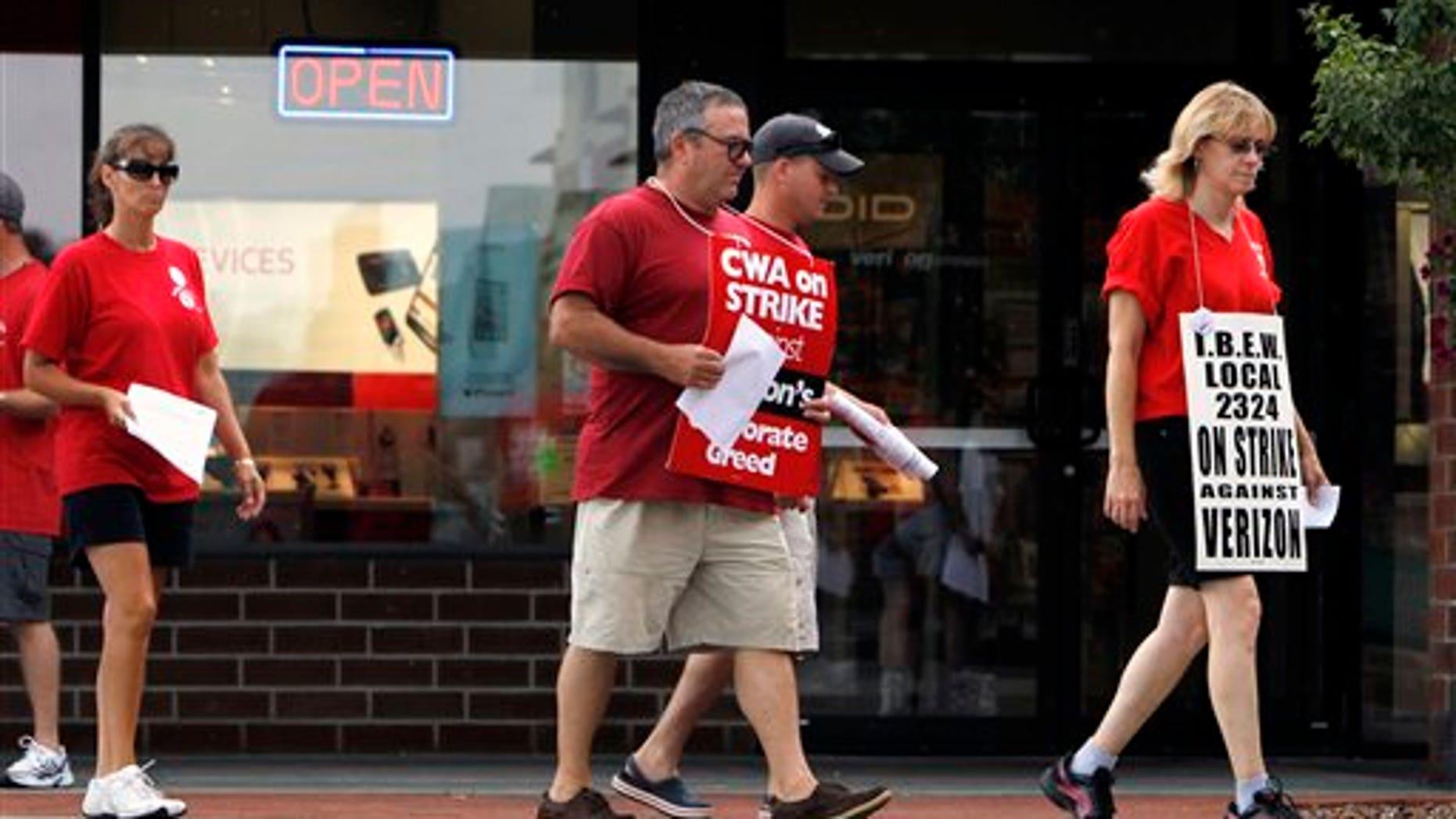 August 8: Striking Verizon workers picket in front of a Verizon Wireless store in Colonie, N.Y.