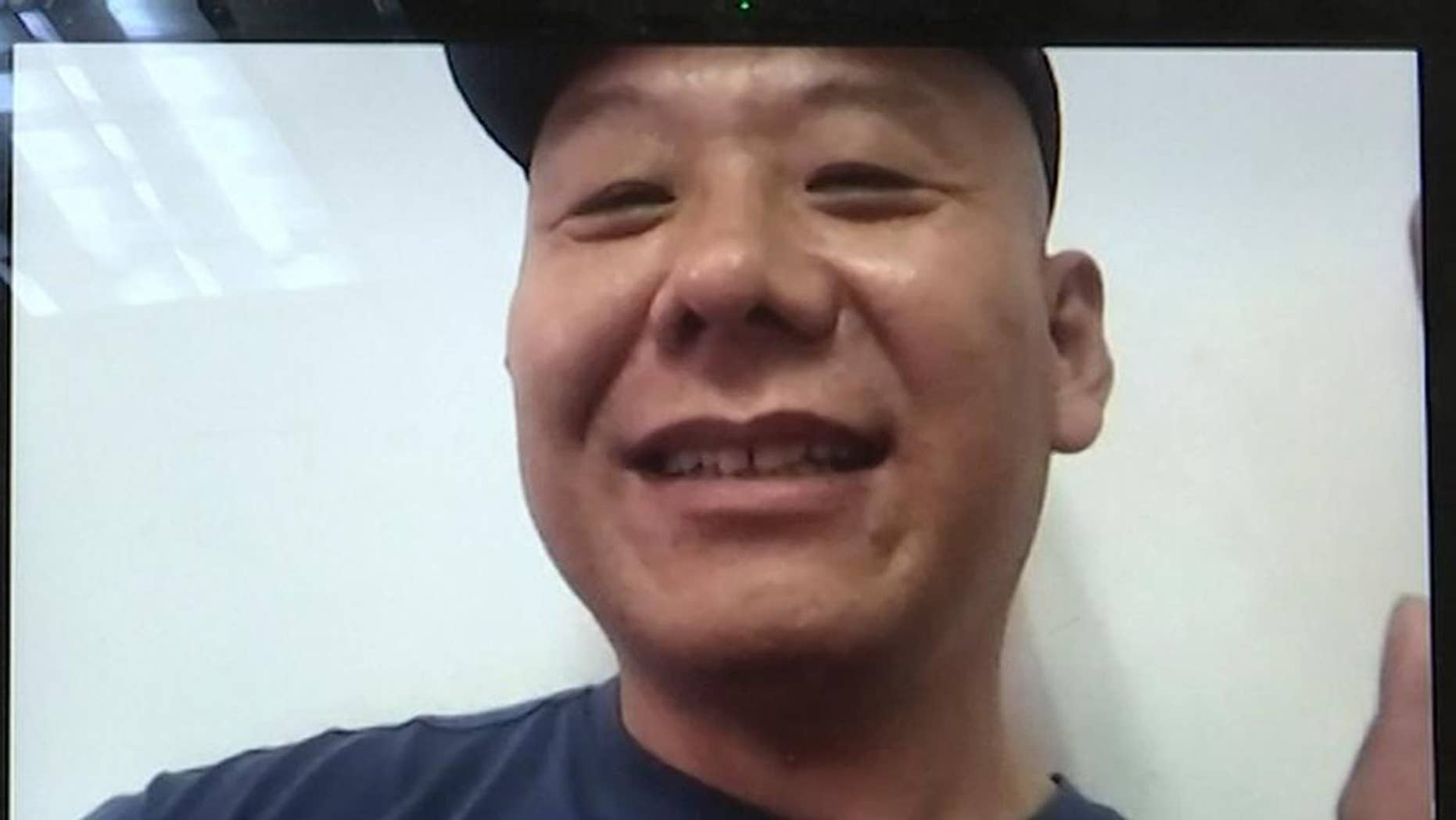 FILE - In this Monday, April 17, 2017, file photo, Chinese dissident Zhang Xiangzhong is seen on a computer screen during an interview via videoconference in Taipei, Taiwan. Taiwan's return Zhang this week is seen by analysts as a possible bid by President Tsai Ing-wen to stabilize relations with Beijing. Officials in Taipei say Chinese national Zhang Xiangzhong lacked legal grounds to stay in Taiwan after breaking away from his tour group on April 13. Analysts say Tsai's administration may be hoping China responds in kind. (AP Photo/Johnson Lai, File)
