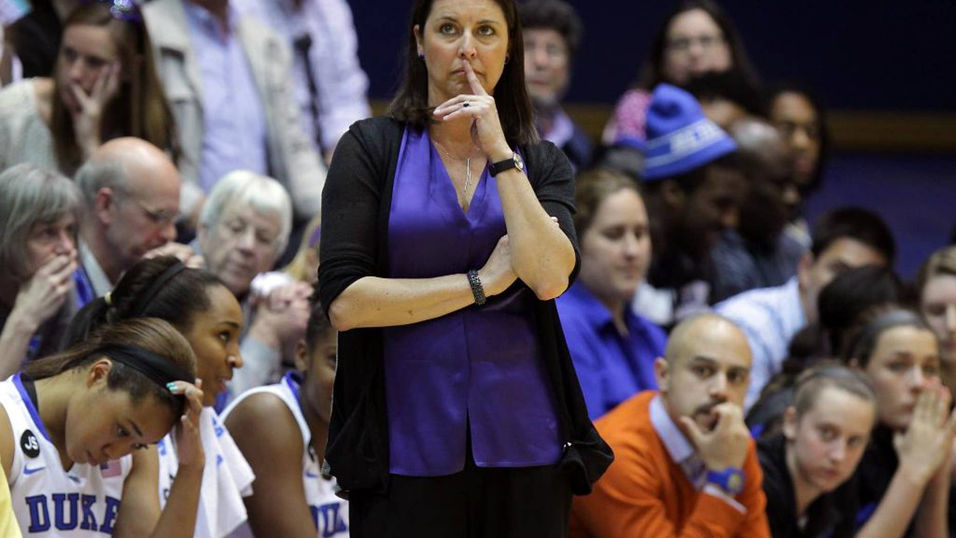 Duke head women's basketball coach Joanne P. McCallie watches game action late in the second half of Duke's 74-65 loss to DePaul in their second-round game in the NCAA basketball tournament in Durham, N.C., Monday, March 24, 2014.  (AP Photo/Ted Richardson)