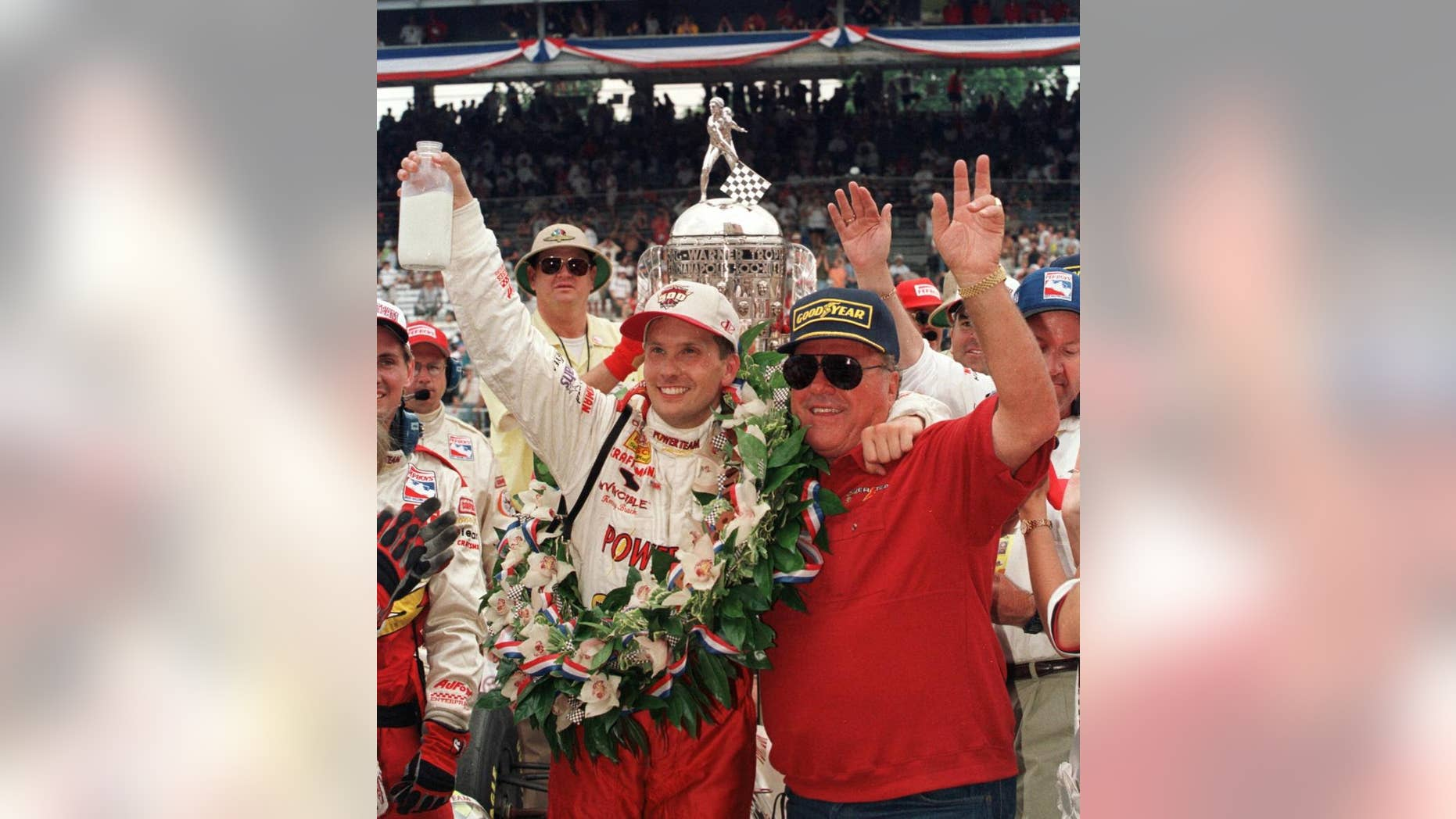 FILE - In this May 30, 1999 file photo, Indianapolis 500 winner Kenny Brack of Sweden, left, and car owner A.J. Foyt of Houston celebrate Brack's win in Victory Lane after the 83rd running of the auto race in Indianapolis.  (AP Photo/Al Behrman, File)