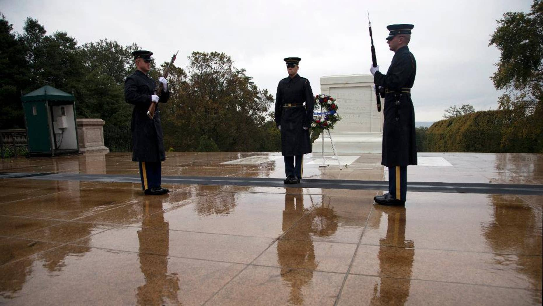 Tomb guards perform the Changing of the Guard at the Tomb of the Unknown Soldier in Arlington National Cemetery in Arlington, Va., Wednesday, Oct. 22, 2014. The military increased security Wednesday at the Tomb of the Unknowns at Arlington National Cemetery after fatal shootings at a Canadian war memorial and Parliament, even though the FBI and the Homeland Security Department said there was no specific threat against the U.S. (AP Photo/Manuel Balce Ceneta)