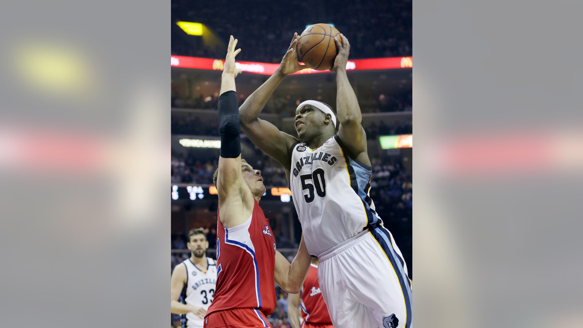Memphis Grizzlies' Zach Randolph (50) shoots over Los Angeles Clippers' Blake Griffin during the second half of Game 4 in a first-round NBA basketball playoff series in Memphis, Tenn., Saturday, April 27, 2013. The Grizzlies defeated the Clippers 104-83. (AP Photo/Danny Johnston)