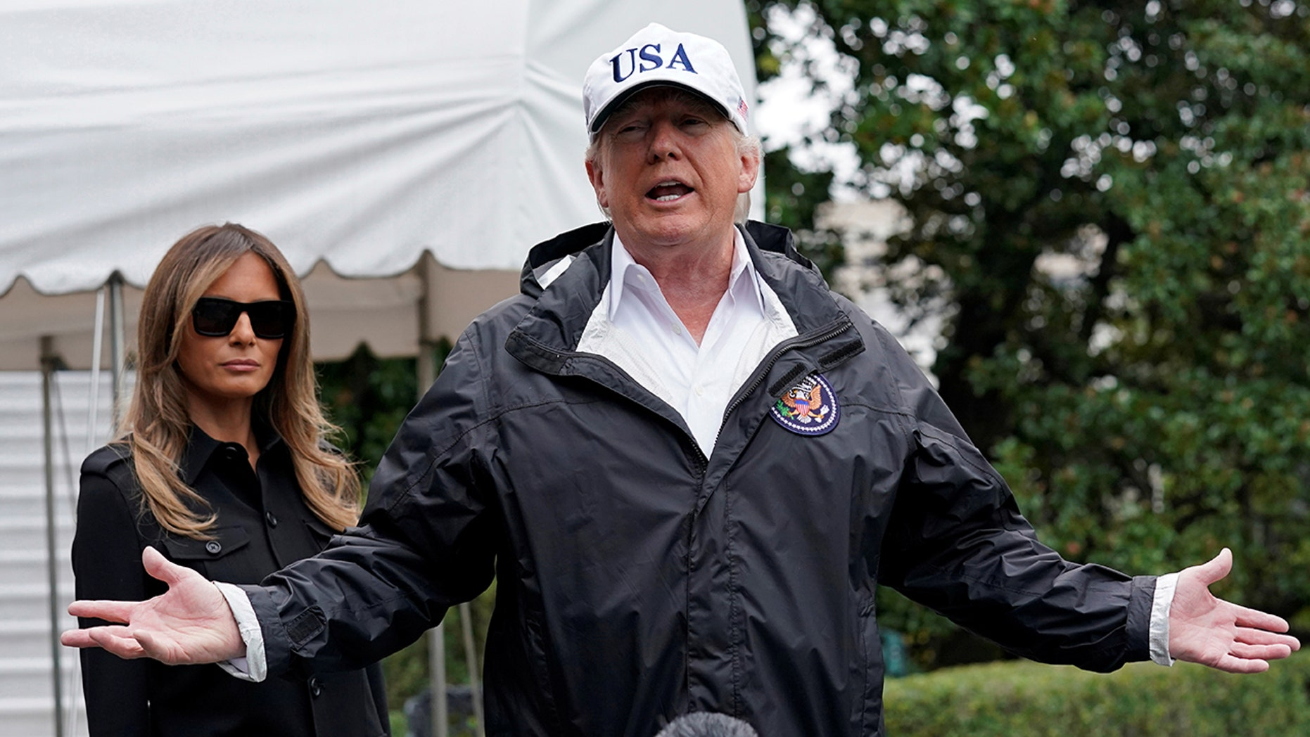 President Trump talks to reporters Thursday as he leaves the White House to asses damage from Hurricane Irma in Florida