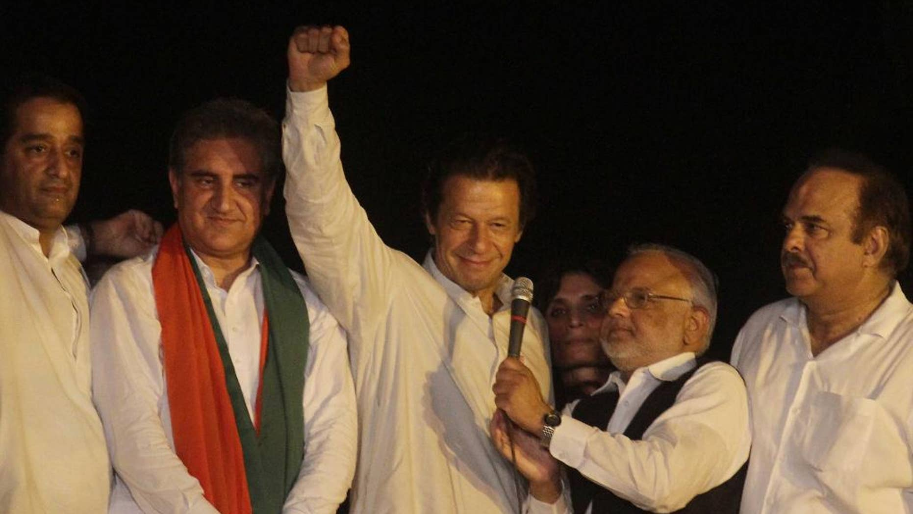Aug. 13, 2014: Pakistan's cricketer-turned-politician Imran Khan, center, gestures during an address to his supporters in Lahore, Pakistan. (AP)
