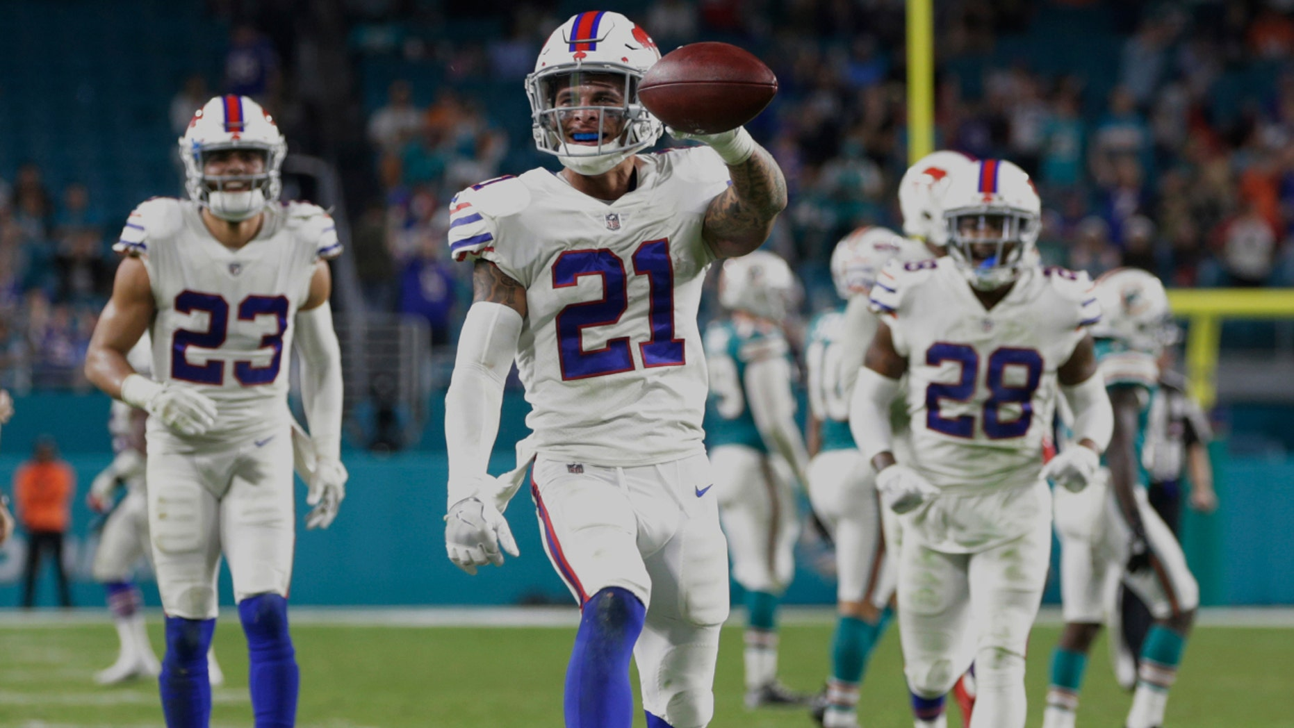 Buffalo Bills free safety Jordan Poyer (21) celebrates an interception against the Dolphins in Miami, Dec. 31, 2017.