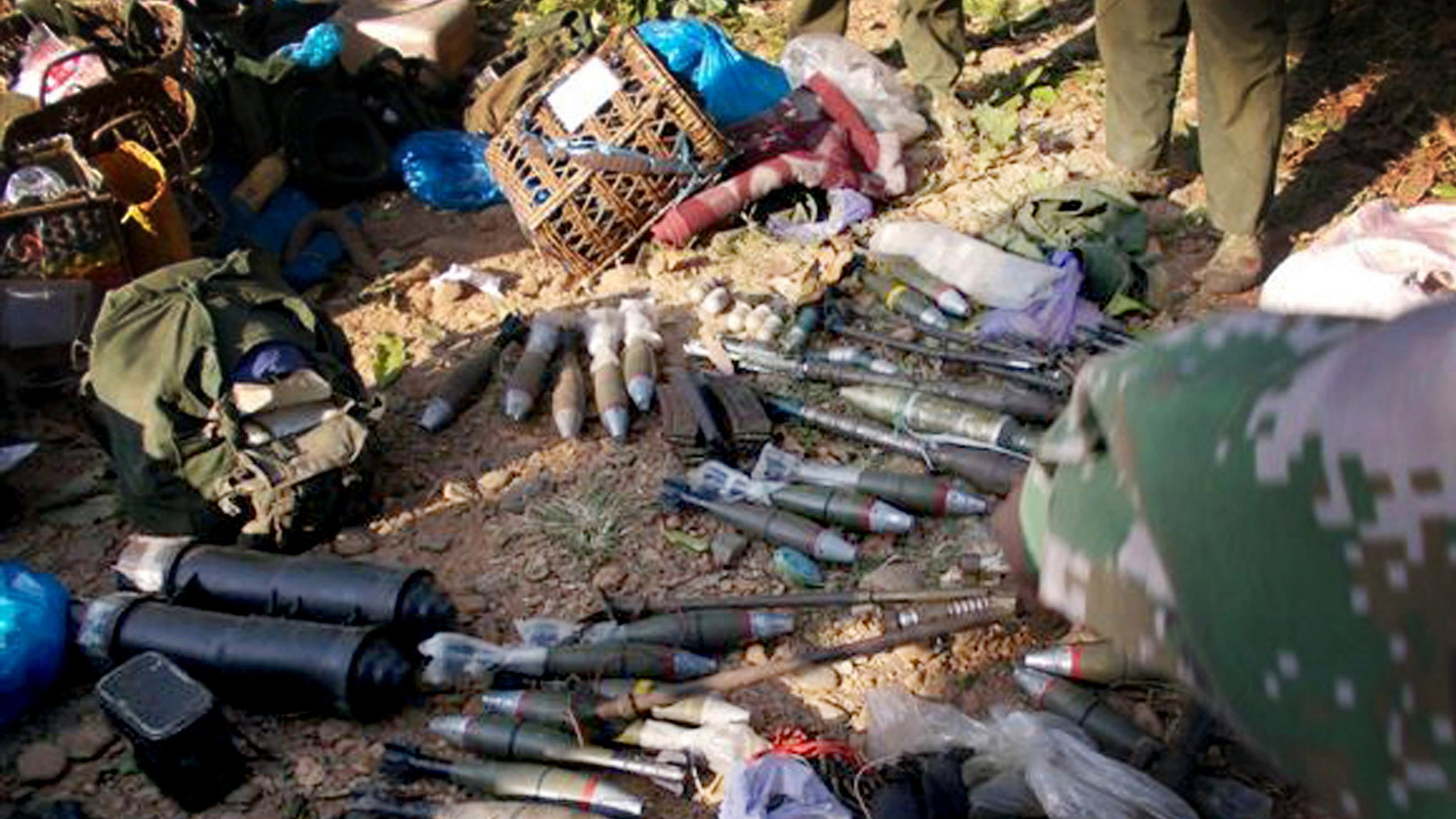 In this photo taken December 15, 2012, and released Monday, Jan. 7, 2013, by Free Burma Rangers, Kachin rebels display the ammunitions they seized from Myanmar soldiers in Laiza, northern Myanmar. Ethnic Kachin rebels in Myanmar accused government troops of launching two artillery attacks Sunday against the city that serves as their headquarters, but no casualties or significant damage were reported. (AP Photo/Free Burma Rangers)