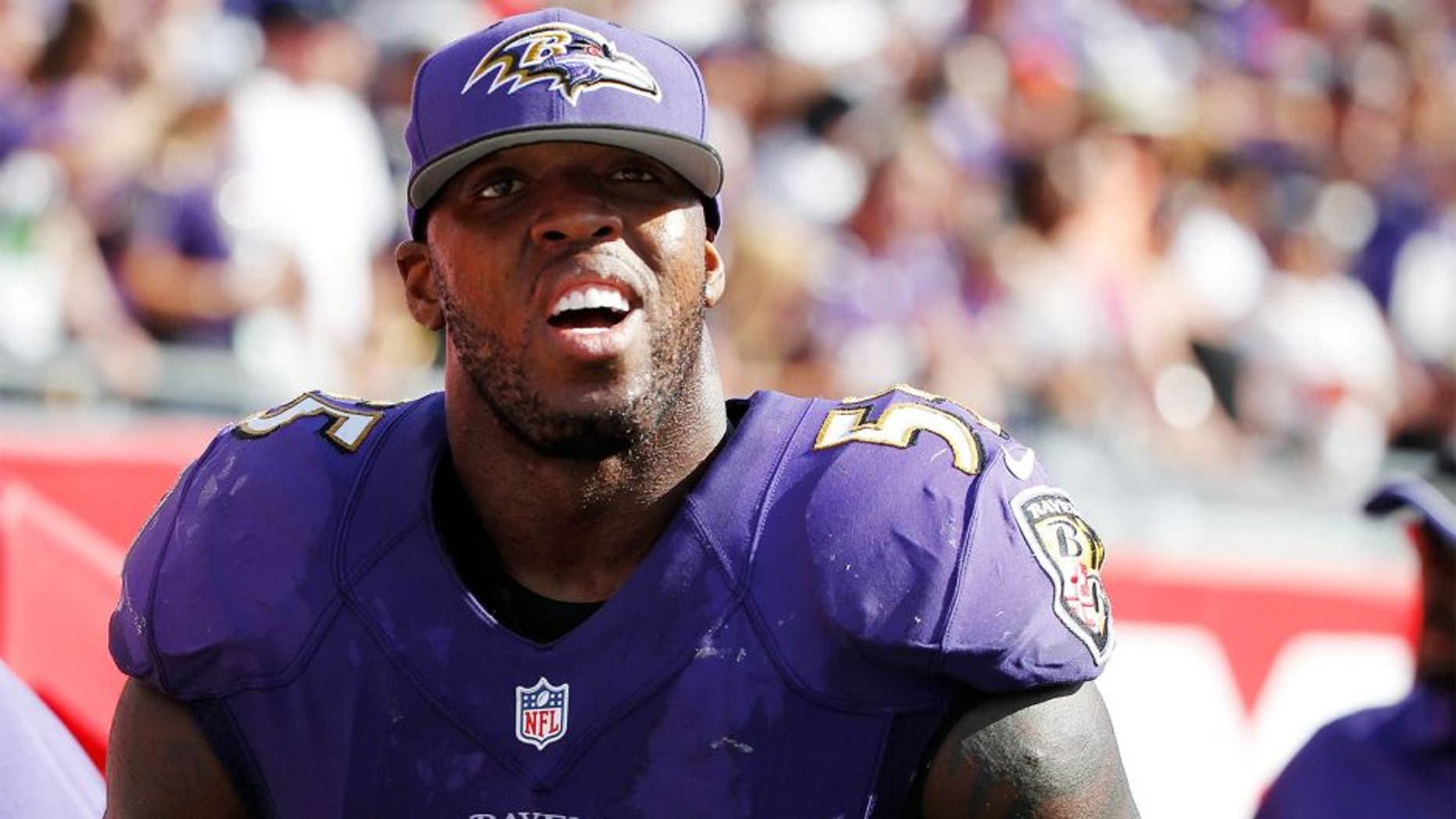 Oct 12, 2014; Tampa, FL, USA; Baltimore Ravens outside linebacker Terrell Suggs (55) against the Tampa Bay Buccaneers during the second half at Raymond James Stadium. Baltimore Ravens defeated the Tampa Bay Buccaneers 48-17. Mandatory Credit: Kim Klement-USA TODAY Sports