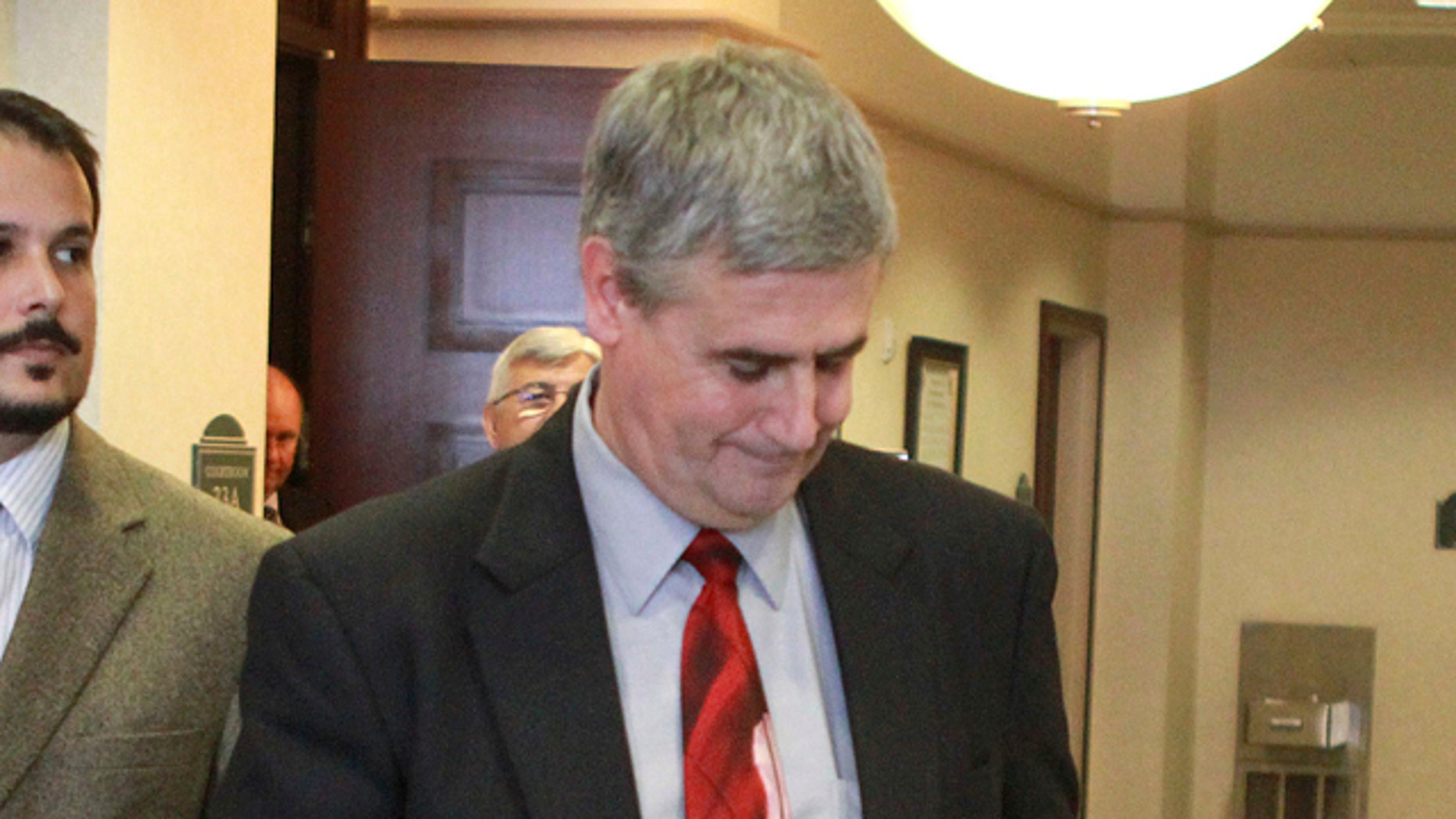 July 5: Prosecutor Jeff Ashton leaves the courtroom after Casey Anthony was found not guilty.