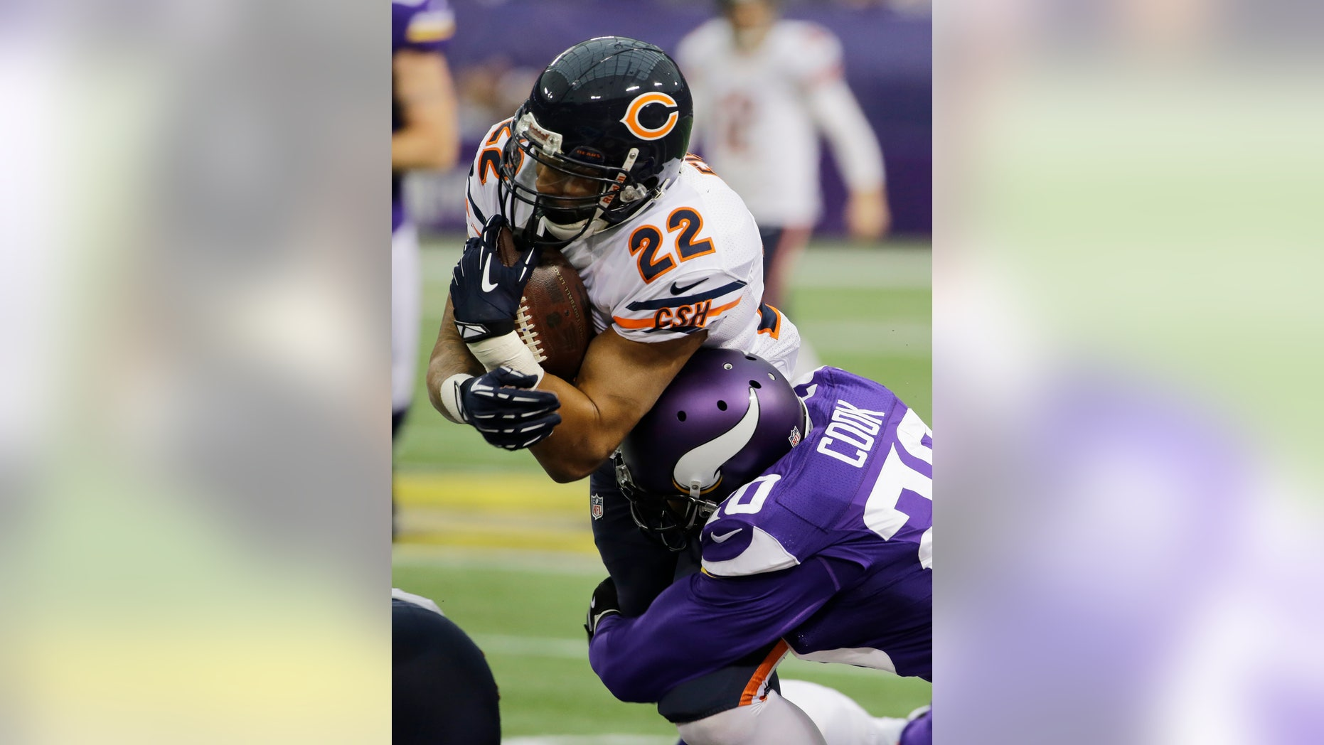 Chicago Bears running back Matt Forte (22) is tackled by Minnesota Vikings cornerback Chris Cook during the first half of an NFL football game on Sunday, Dec. 1, 2013, in Minneapolis. (AP Photo/Ann Heisenfelt)