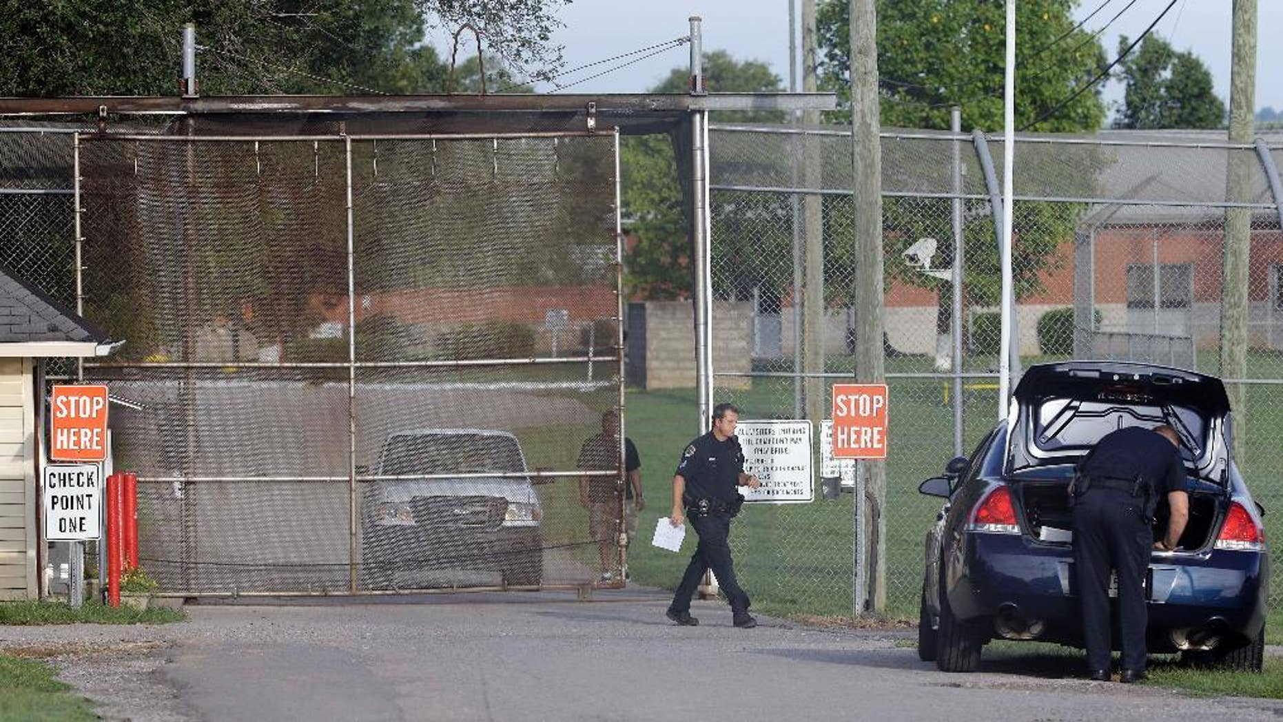 FILE - In this Sept. 2, 2014 file photo, police work in front of the Woodland Hills Youth Development Center in Nashville, Tenn.  Thirteen teenagers escaped overnight from the youth detention center in Nashville but all but one were recaptured within hours, authorities said Saturday, Sept. 27, 2014, marking the latest of a rash of security breaches involving the Woodland Hills Youth Development Center.  (AP Photo/Mark Humphrey)