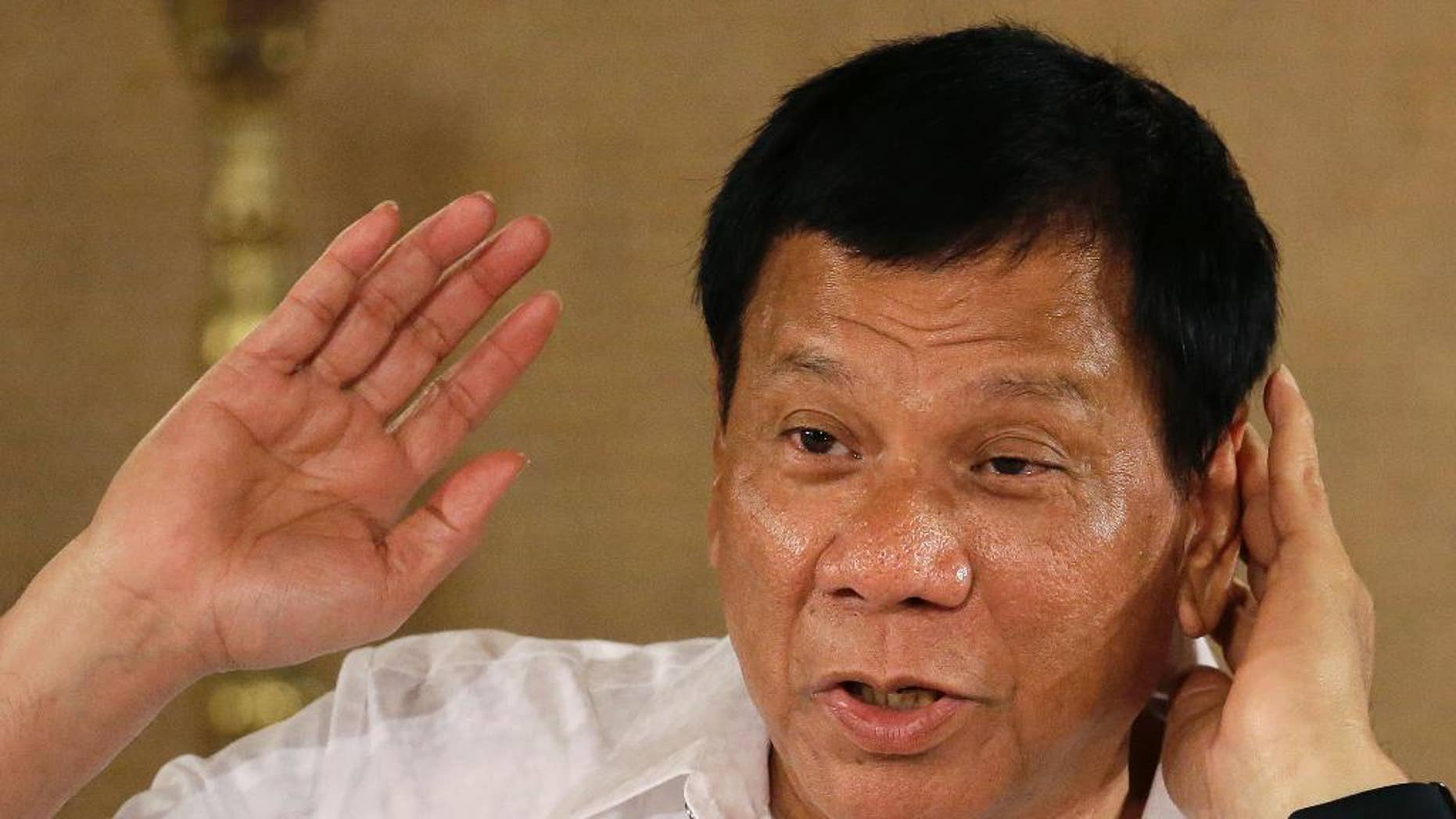FILE - In this March 13, 2017 file photo, Philippine President Rodrigo Duterte gestures as he answers questions from reporters during a press conference at the Malacanang presidential palace in Manila, Philippines. A Philippine lawmaker filed an impeachment complaint against President Duterte on Thursday, March 16, 2017,  because of the thousands of deaths that have happened in his anti-drug crackdown and for alleged corruption, although the bid faces an uphill battle with Duterte's allies holding an overwhelming majority in Congress. (AP Photo/Aaron Favila, File)