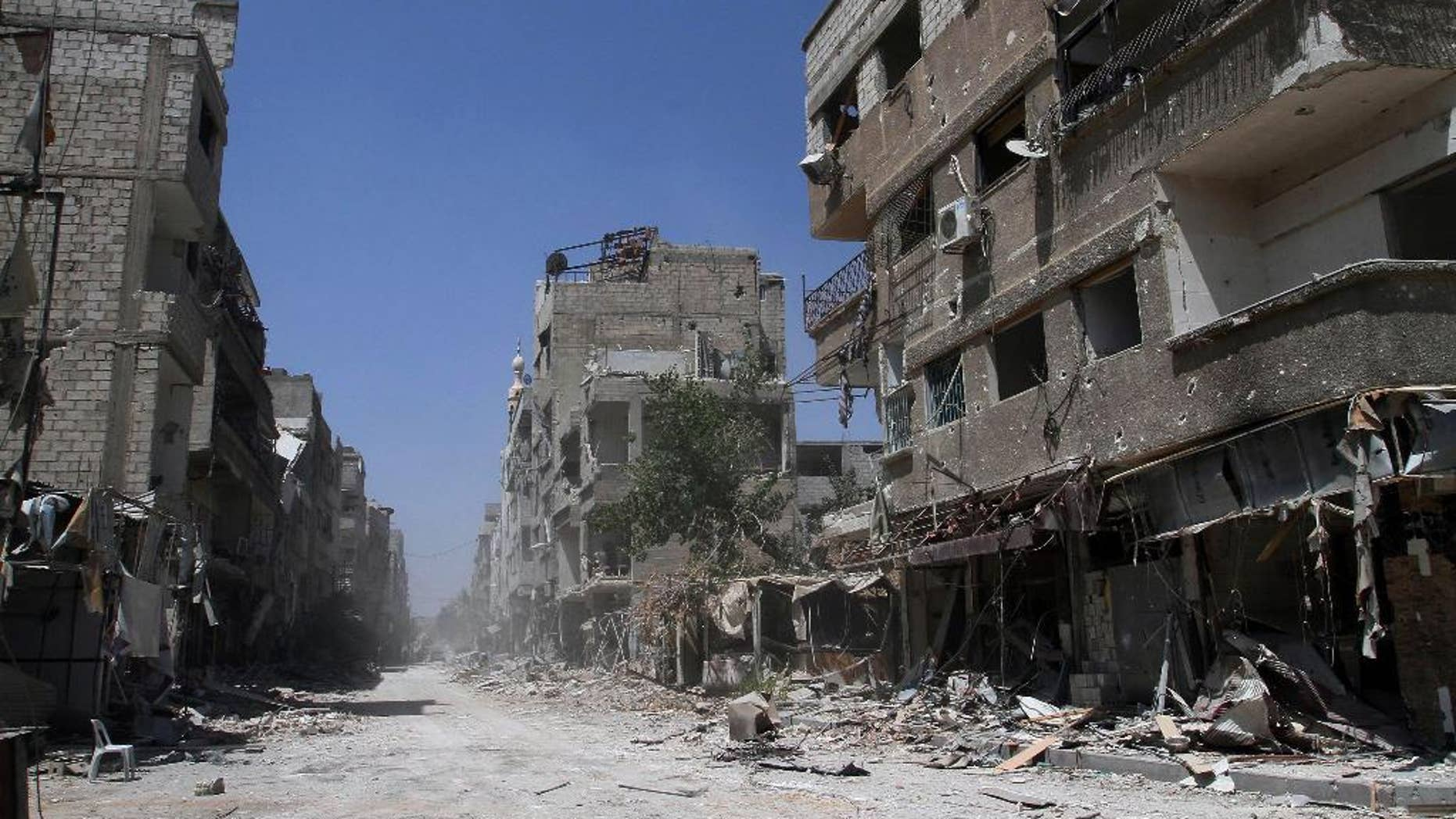 Aug. 15, 2014: In this photo taken during a Syrian government-led media tour, buildings damaged during battles between Syrian troops and rebels stand along an empty street in Mleiha, some 6 miles southeast of downtown Damascus, Syria. (AP)