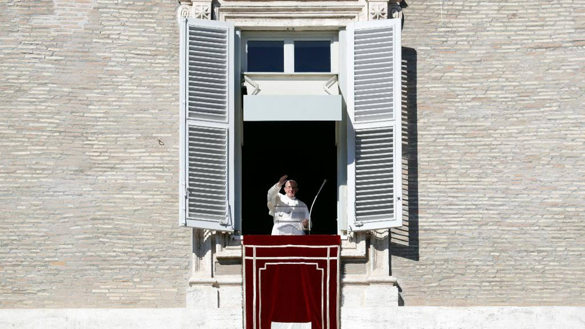 Pope Francis delivers his blessing during the Angelus noon prayer he celebrated from the window of his studio overlooking St. Peter's Square, at the Vatican, Sunday, Oct. 30, 2016. (AP Photo/Andrew Medichini)